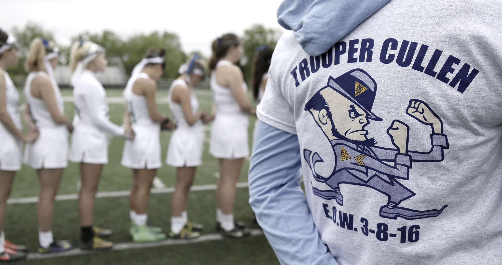 Camden Catholic girls´ lacrosse players line up for a moment of silence for N.J. Trooper Sean Cullen, who was killed in a March traffic accident. ELIZABETH ROBERTSON / Staff Photographer