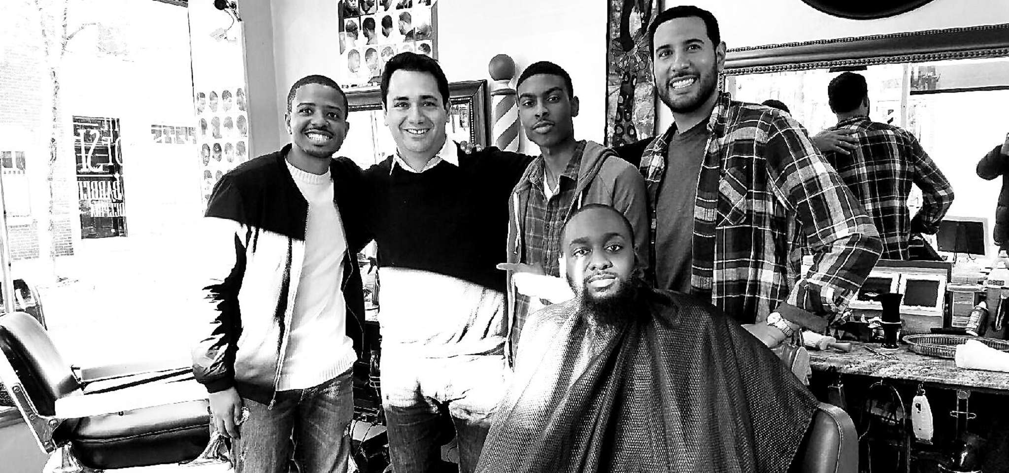 Diego Rivera (second from left) with actors from the McDonald´s commercial that was filmed at Rivera´s barbershop King of Shave on Pine Street.