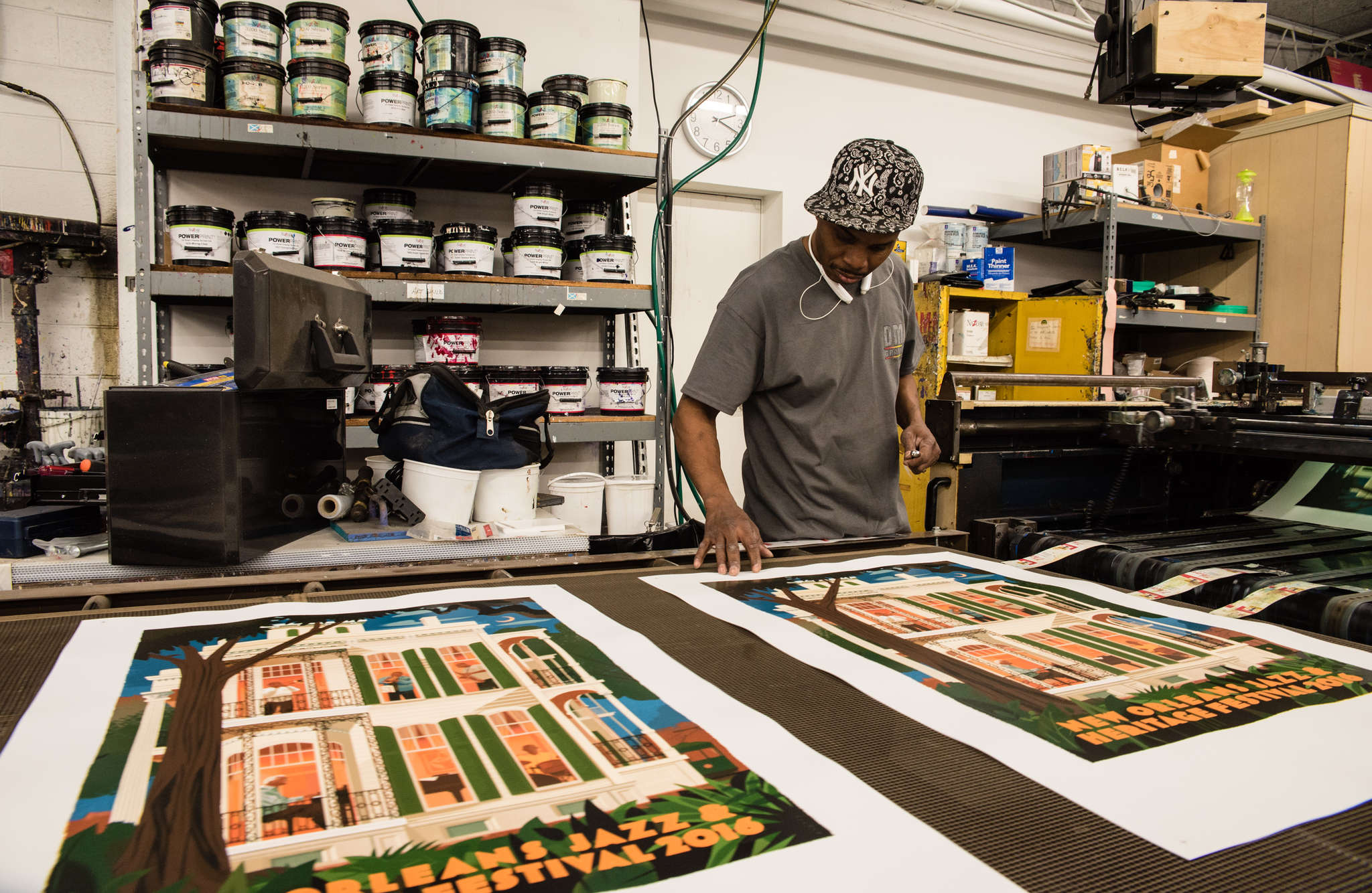 Joe Edwards checks the ink at DMR Graphics in West Conshohocken. DMR´s posters for the New Orleans Jazz & Heritage Festival have become collector´s items.