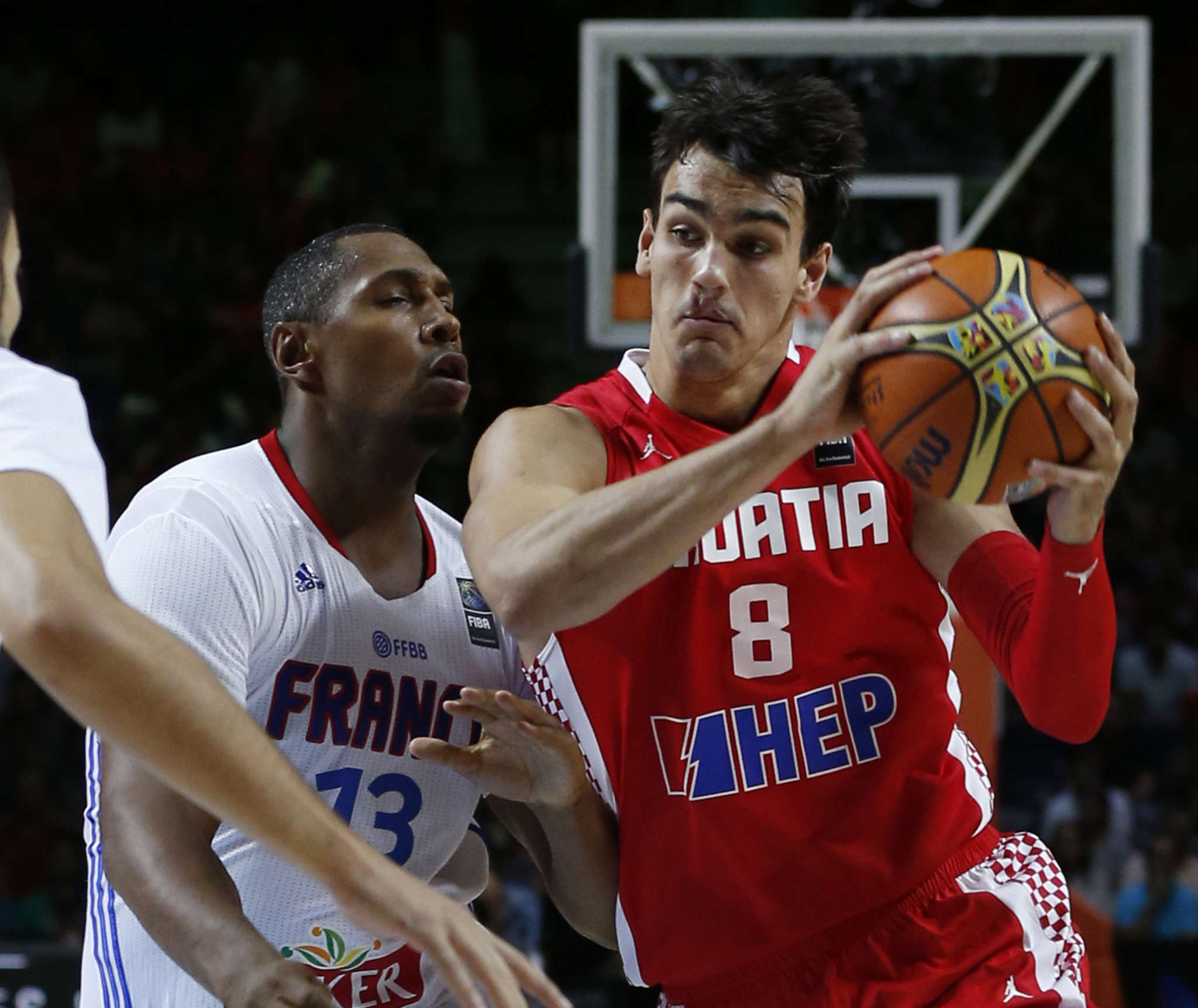 Dario Saric (right) has a financial incentive to play in Europe another year, but the Sixers need to stress how important he is to them. Associated Press