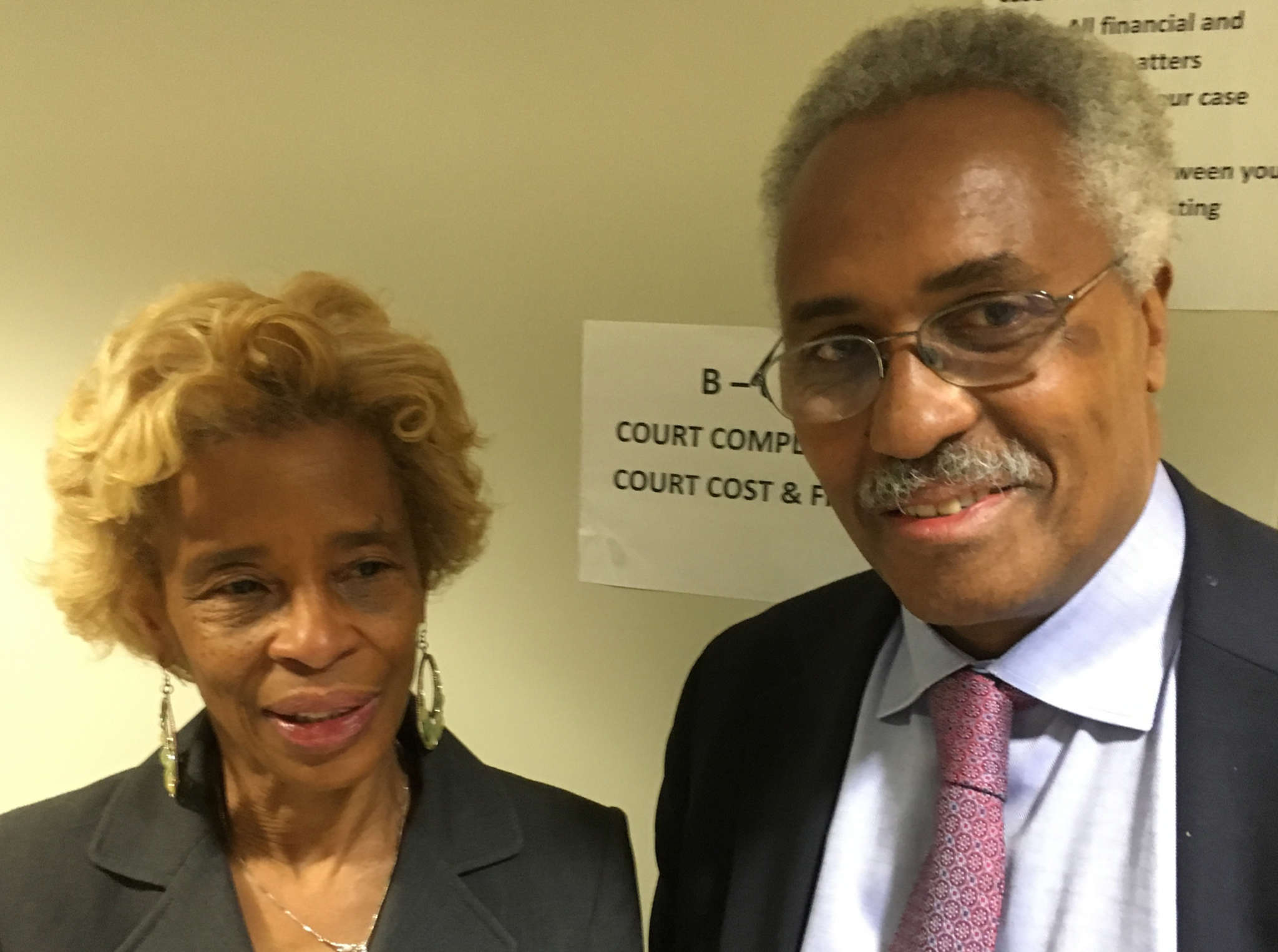 Dog owner Ada Brooks, outside Municipal Court with Democratic committeeman Maurice Sampson.
