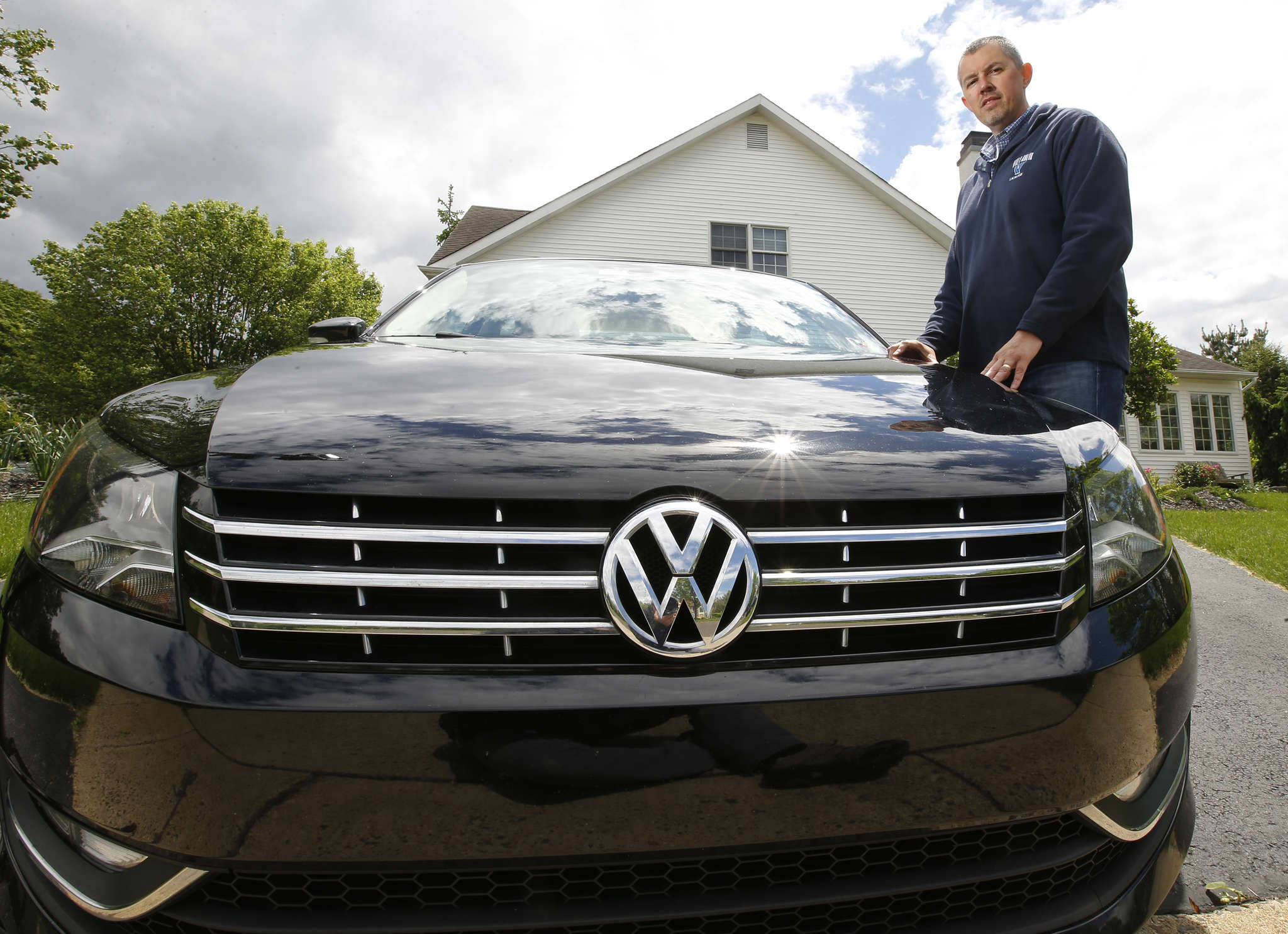 Joe Lingle of Yardley with his Volkswagen Passat TDI. Fuel economy is what´s important to him, so he might be willing to keep the car if the fix does not hurt his gas mileage.