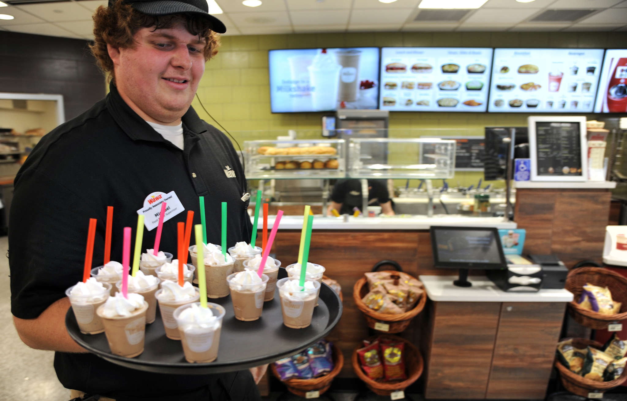 Food and beverage supervisor Mike Eckerle offers customers free milkshake samples in a remodeled store in Conshohocken.