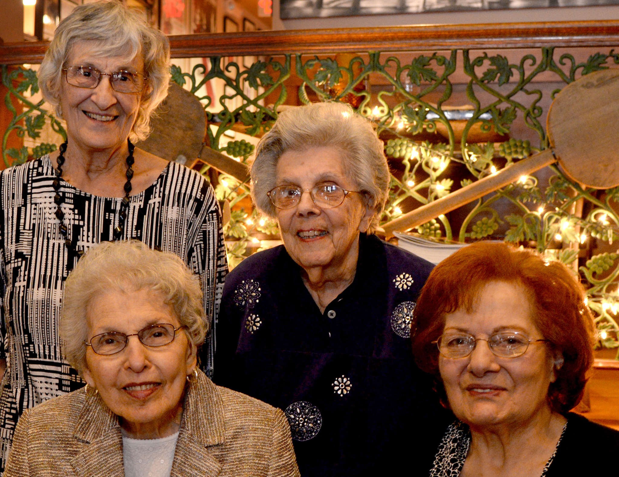 Friends for eight decades: Regina Braccili, and Regina Luchi (standing, from left), with Rita LaRocca (left) and Anna Marie Campagna at this year´s gathering at Francoluigi´s in South Philly.