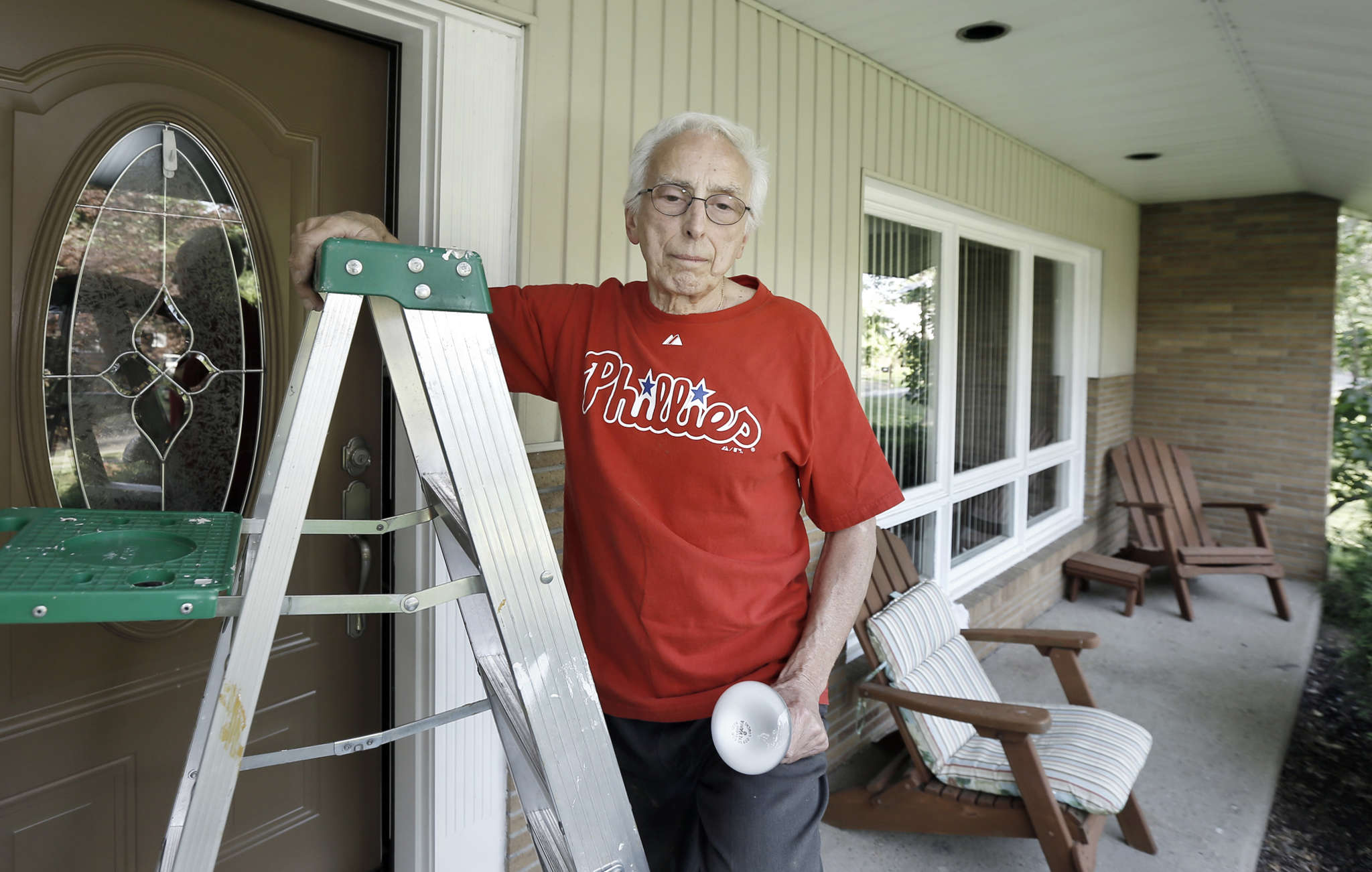 "Carmen Argentina, 80, maintaining his home in the Kingston Estates neighborhood. A real estate agent made an unsolicited offer to buy his house. ""I told her, ´I´m not moving.´ """