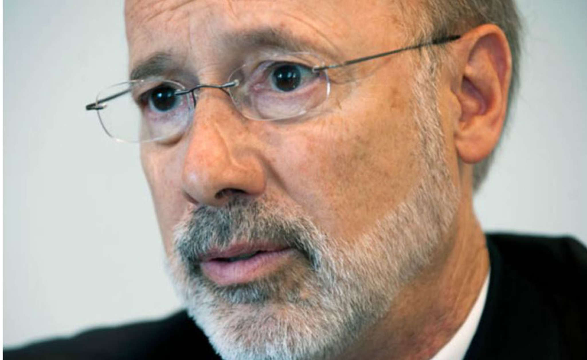 Gov. Wolf: No time to toast with another budget at his throat.