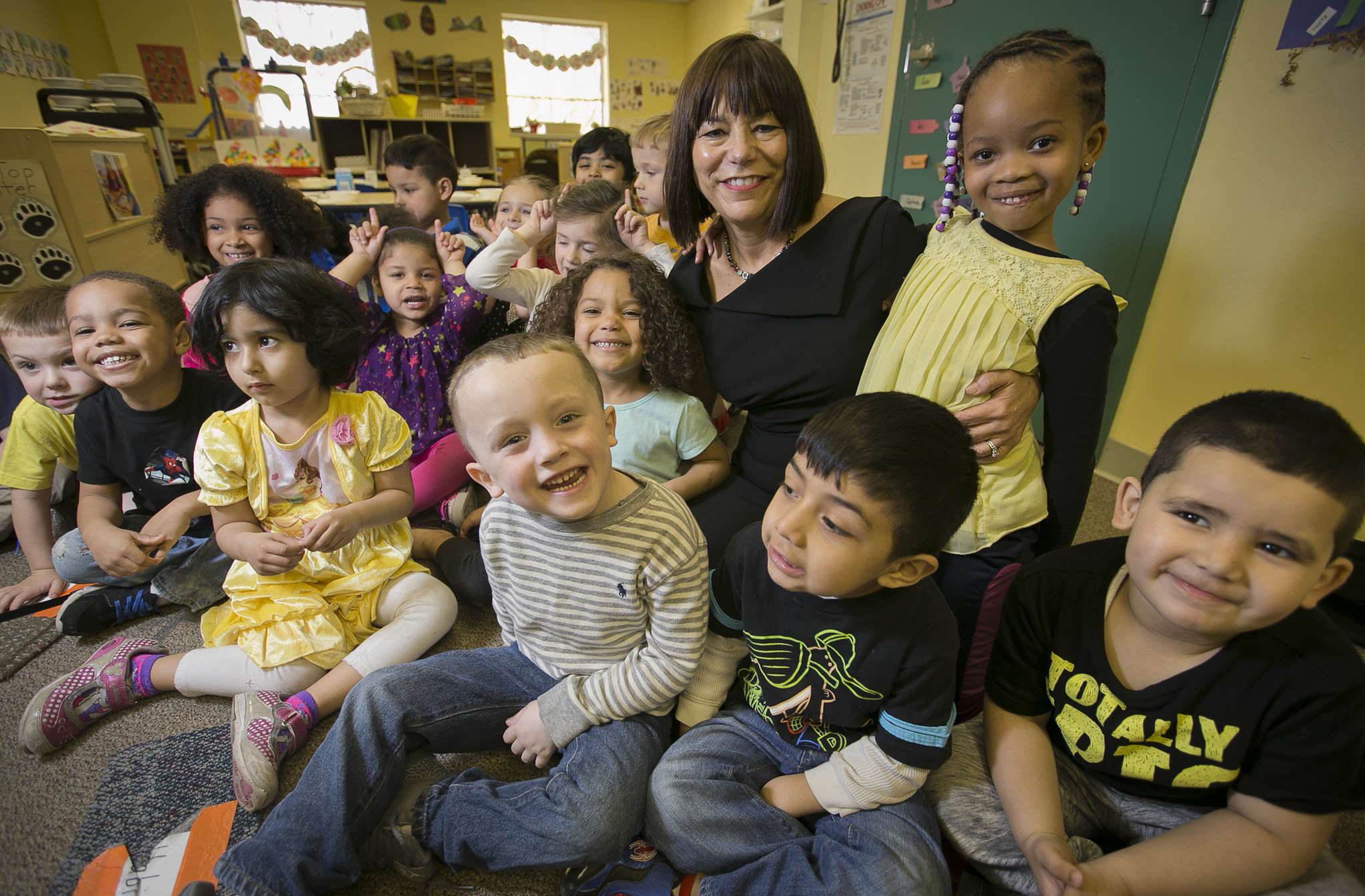 Kathy McHale, president of Special People in Northeast Inc. (SPIN), with a group of 3- and 4-year-olds. Since high school, McHale has been drawn to altruism and volunteering.