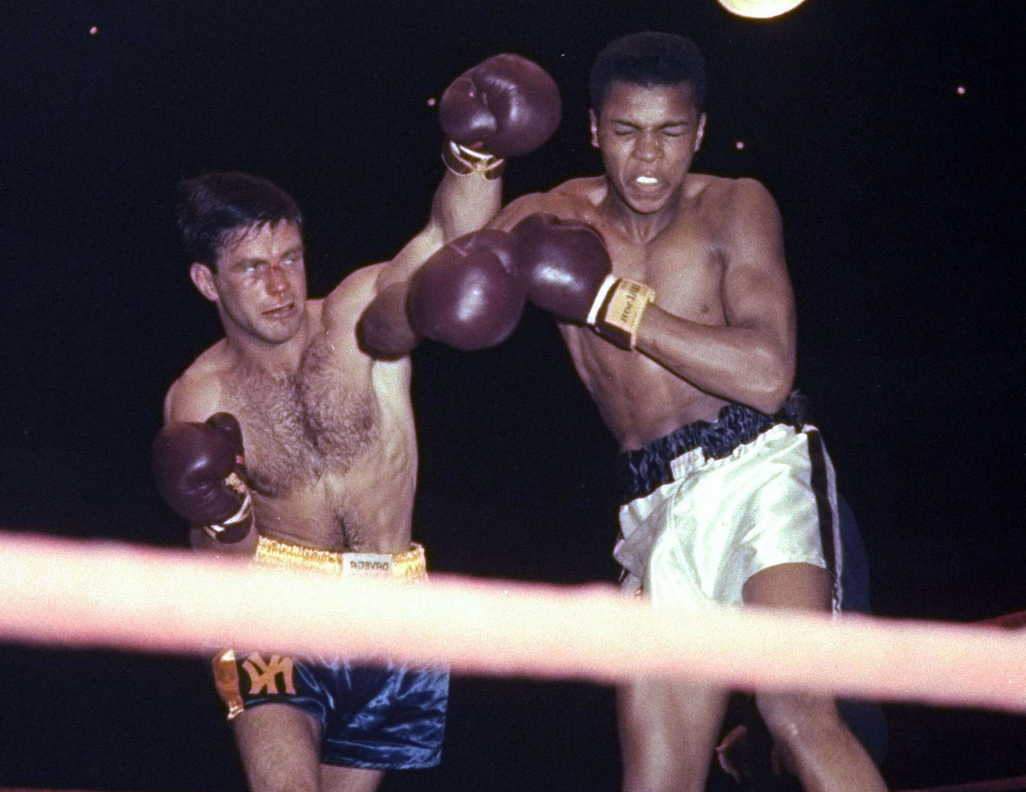 Cassius Clay, then 17, in a 1959 Golden Gloves bout with Tony Madigan.