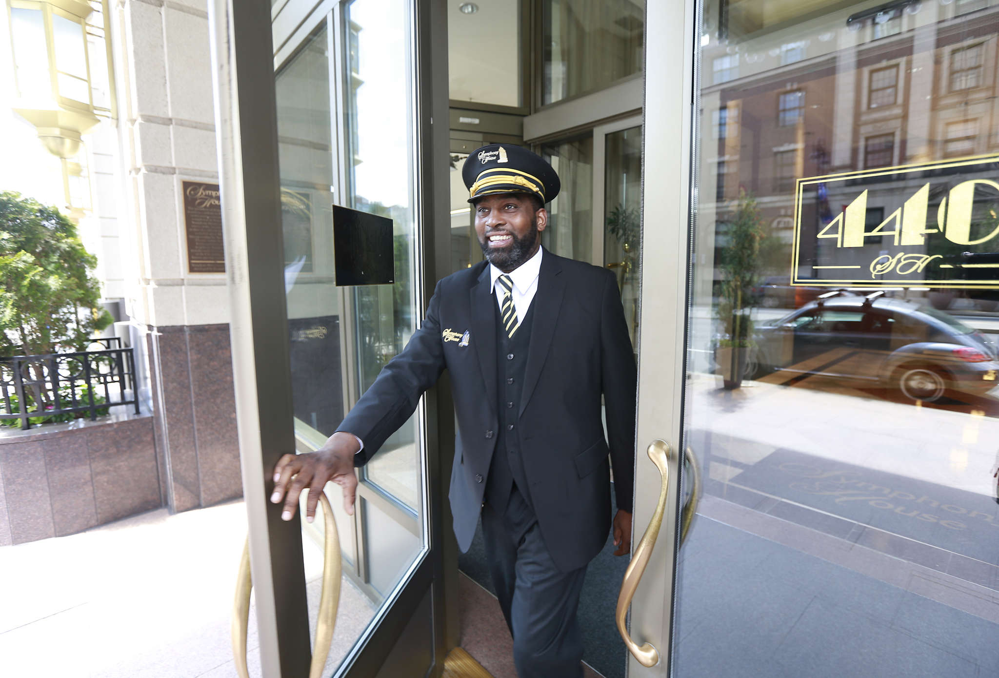 Andrew Monroe (above) is the doorman at Symphony House on South Broad Street. Buyers pick condos because of the convenience of one-level living, and the security of a doorman. DAVID SWANSON