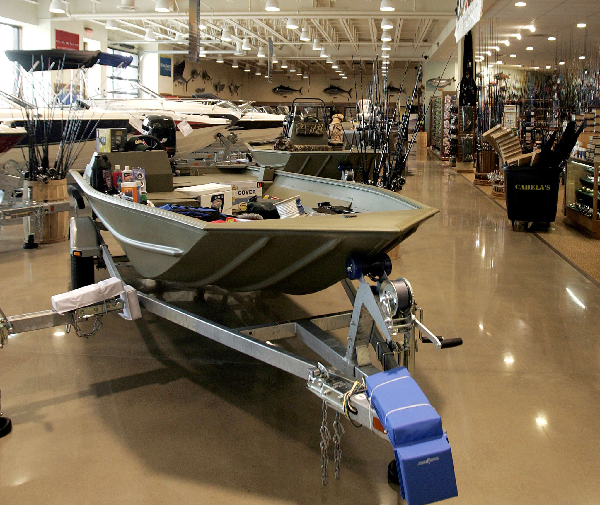 Boats, big and small , are offered for sale at a Cabela´s store in East Hartford, Conn. BOB CHILD / Associated Press