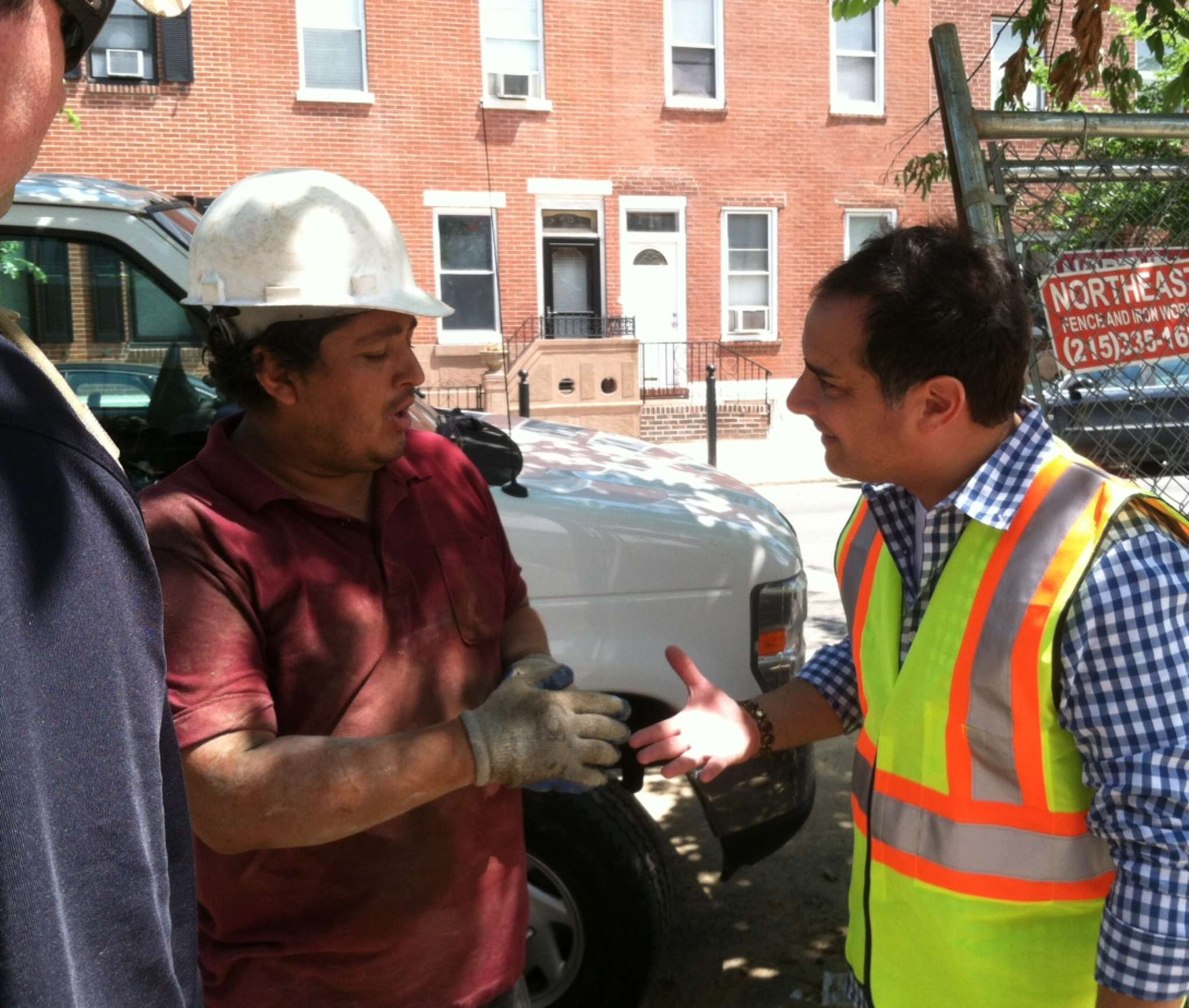 Nick DeJesse (right) talks to a construction worker at a South Philadelphia job site. DeJesse is Philadelphia director of the Occupational Safety and Health Administration.