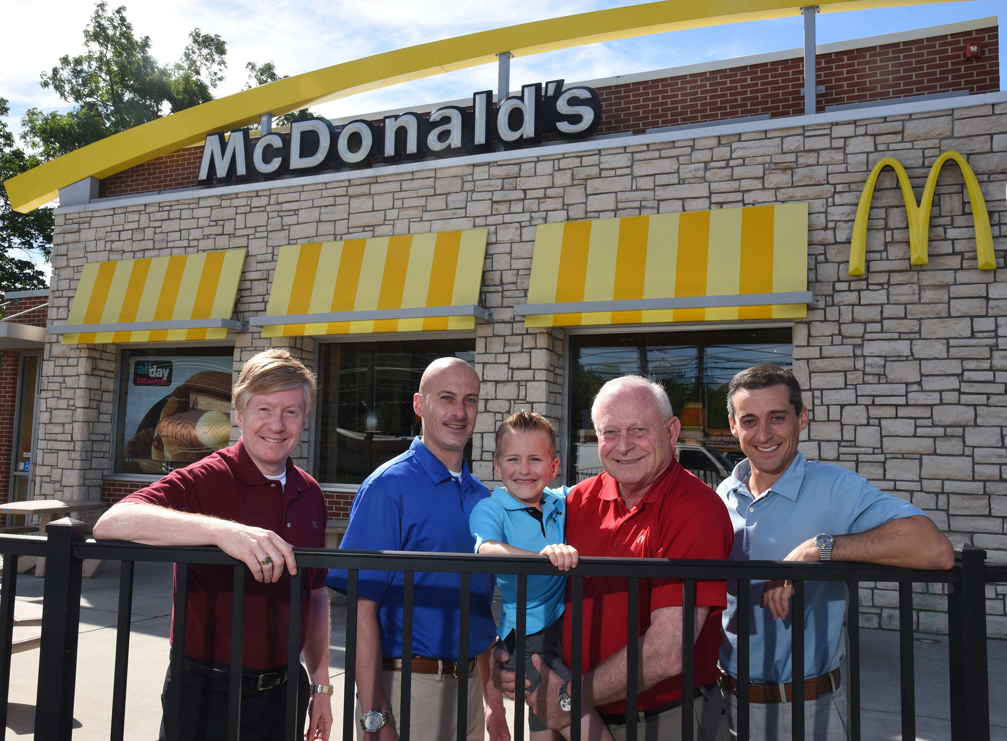 Three generations of Dukarts at their Morrisville McDonald´s: ( From left) Alan Dukart, 59; Michael, 41, Michael´s son Eli, 6; Les, 69; and Joel, 38.