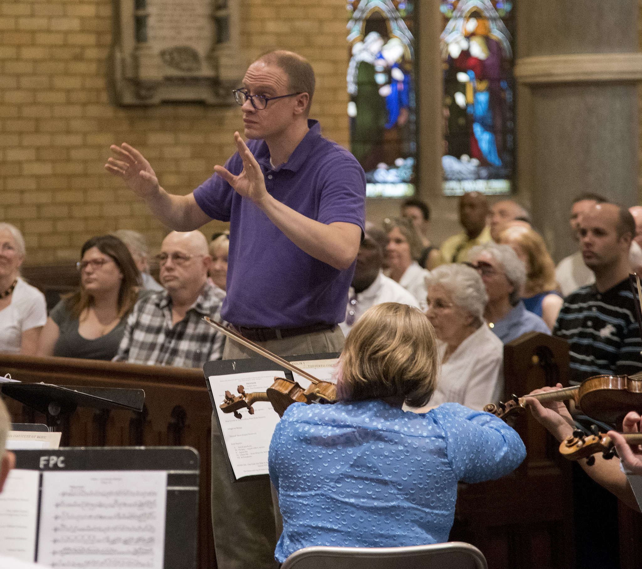 Andrew Senn conducts an antiviolence concert in memory of victims of the Orlando massacre.