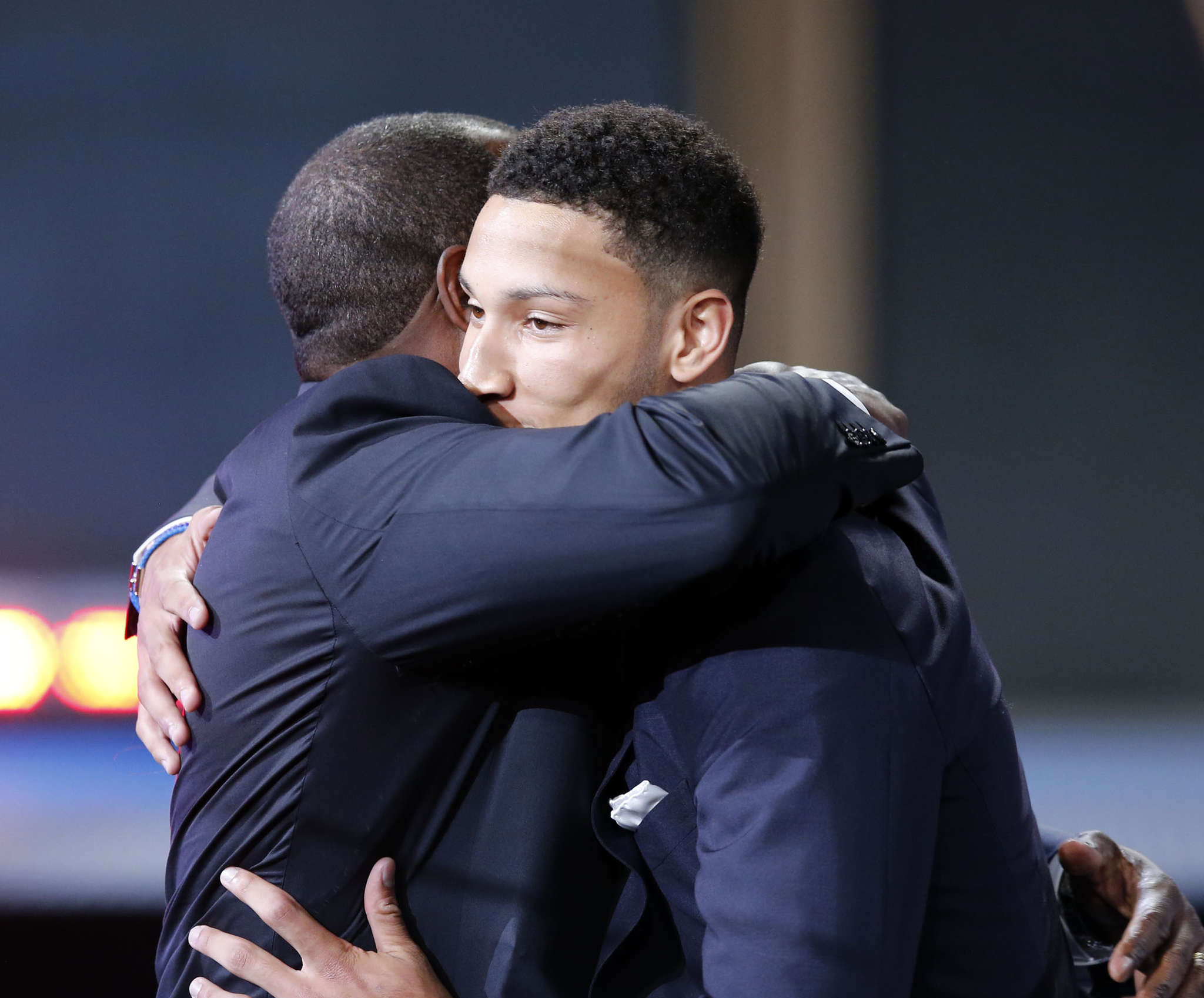 Ben and Dave Simmons embrace after Sixers made Ben the first pick in the draft.
