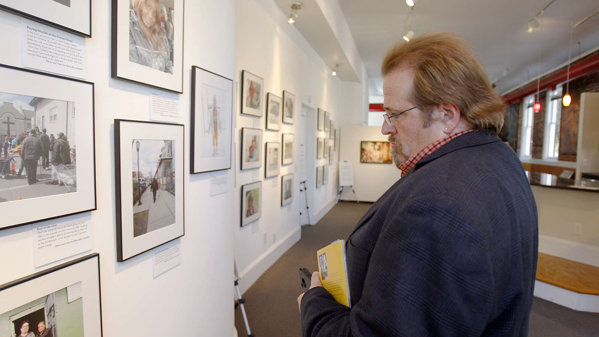 "Tom Johnson-Medland at the ""Witness to Hunger"" photo exhibit at Gallery Eleven One in Camden in 2013. The art exhibition space has now closed."