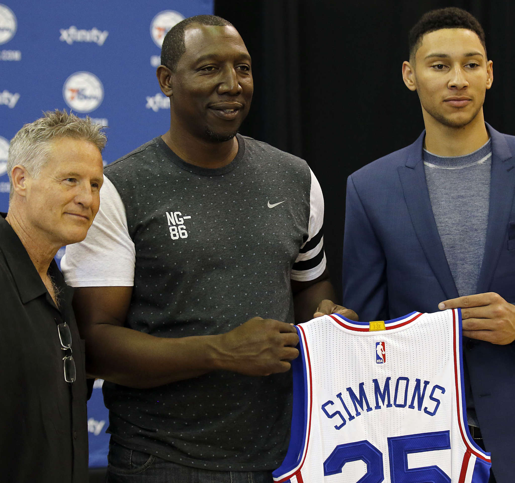 Brett Brown poses with a former player of his, David Simmons, and his newest, Ben Simmons. YONG KIM / Staff Photographer
