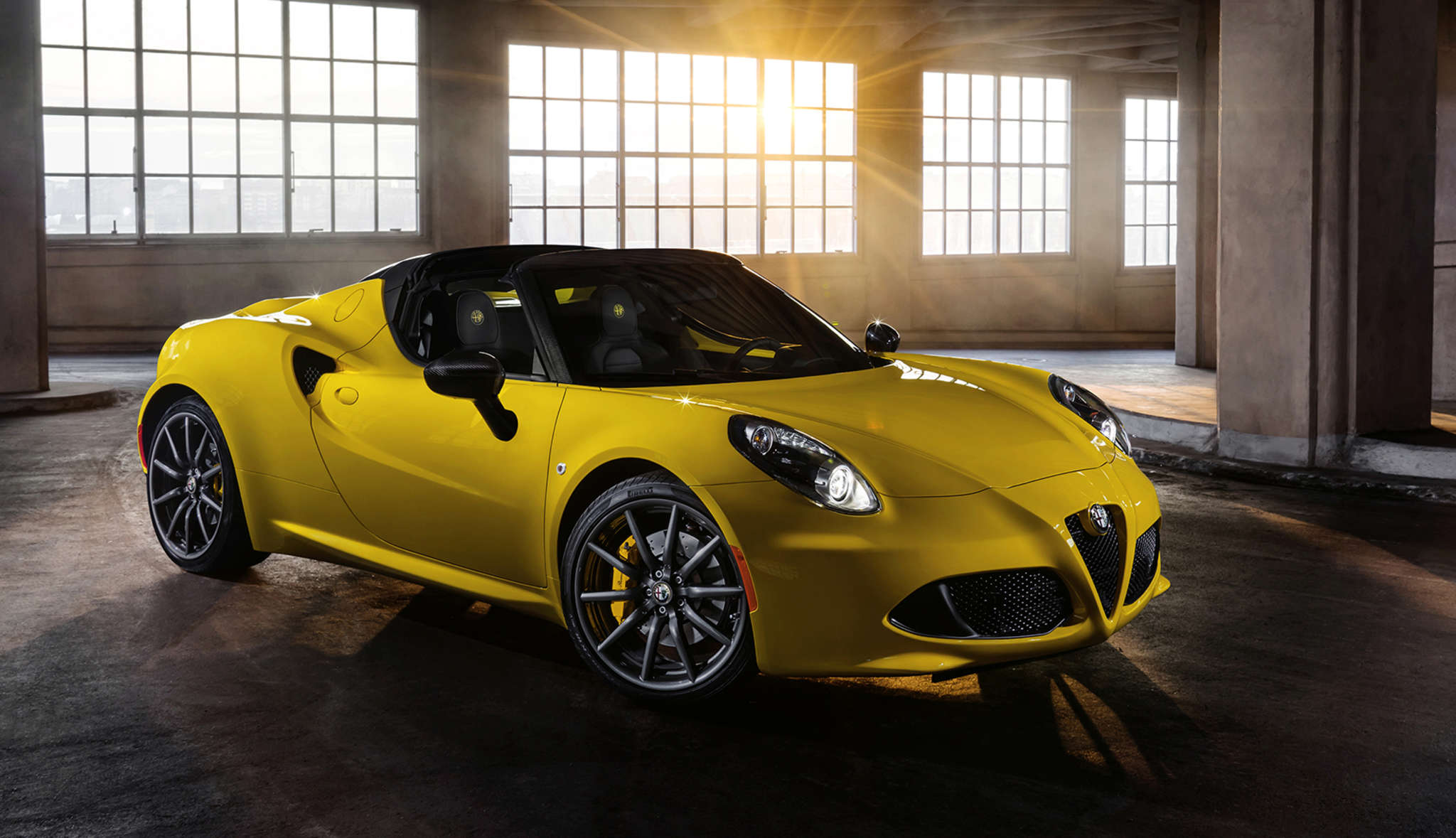 The 2016 Alfa Romeo 4C Spider sits low to the ground and weighs just 2,487 pounds. It´s fun to drive, with reservations.