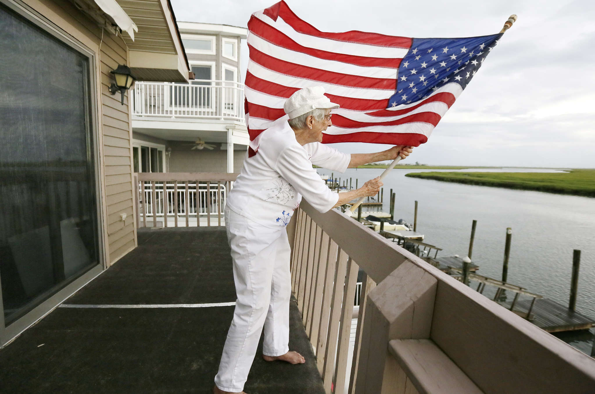 Henrietta Creighton, known as Grandma Etta, 92, puts her flag out at her Shore home.