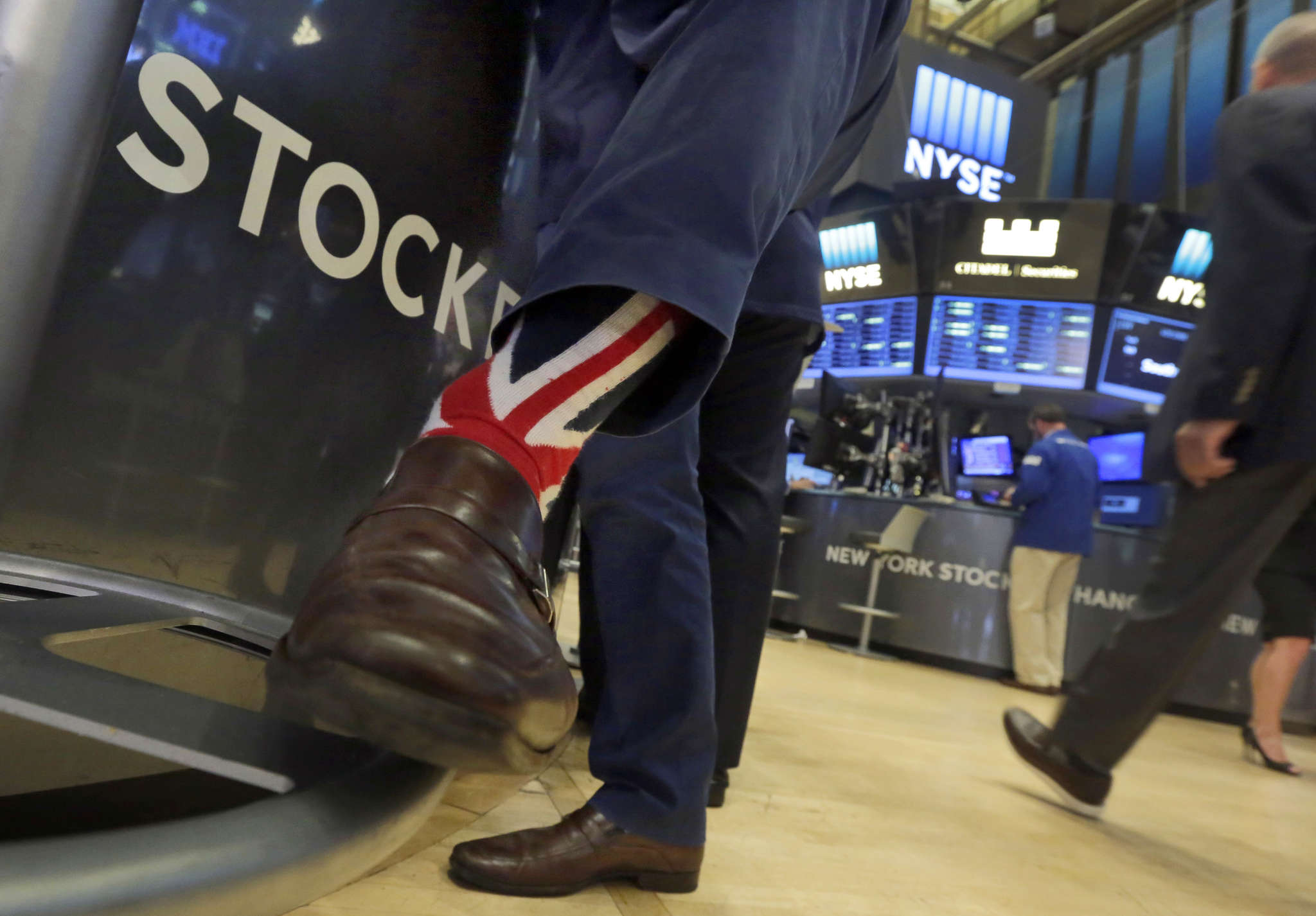 Stocks specialist Michael Pistillo sported Union Jack socks while working on the floor of the New York Stock Exchange on Friday.