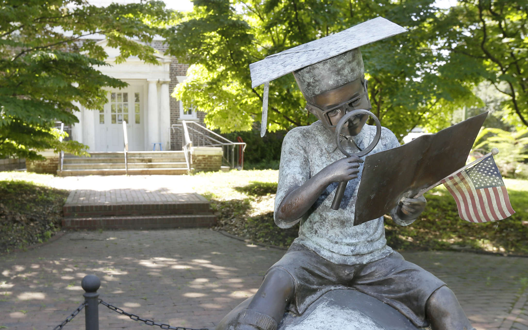 "The statue ""Boy Reading on Top of the World"" at Haddonfield Public Library, where a renovation is nearly complete."