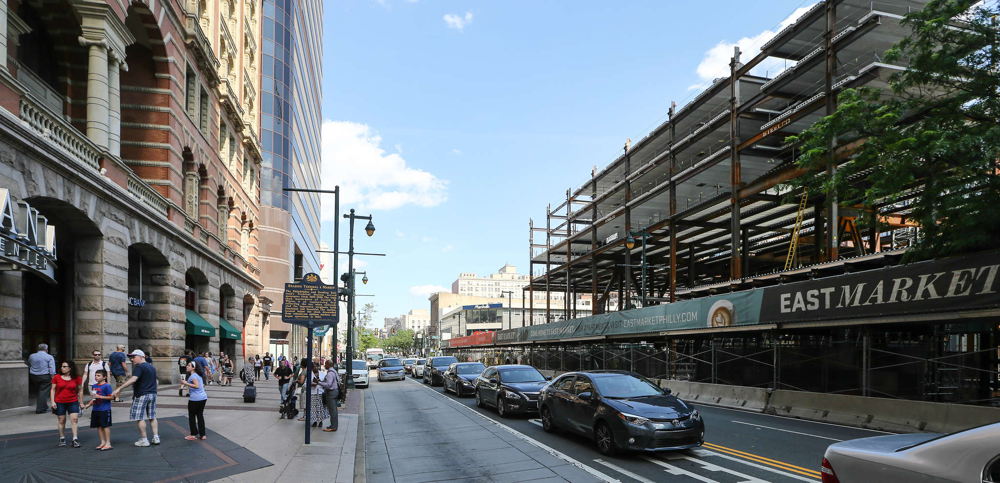At 11th and Market Streets, a banner along a construction site touts the East Market retail and residential project, which will stretch to Chestnut Street.