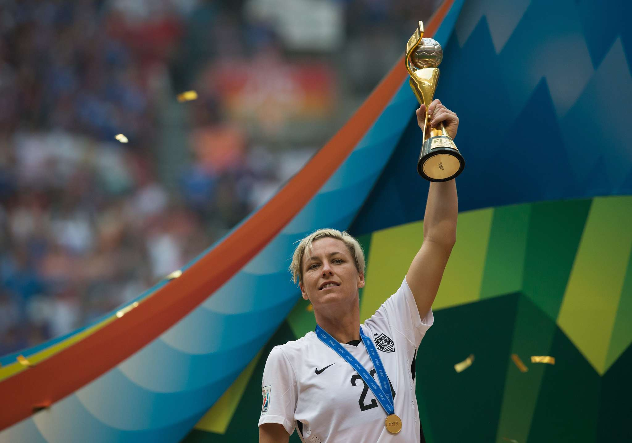 Abby Wambach, with the 2015 World Cup soccer trophy, will also speak here this fall.