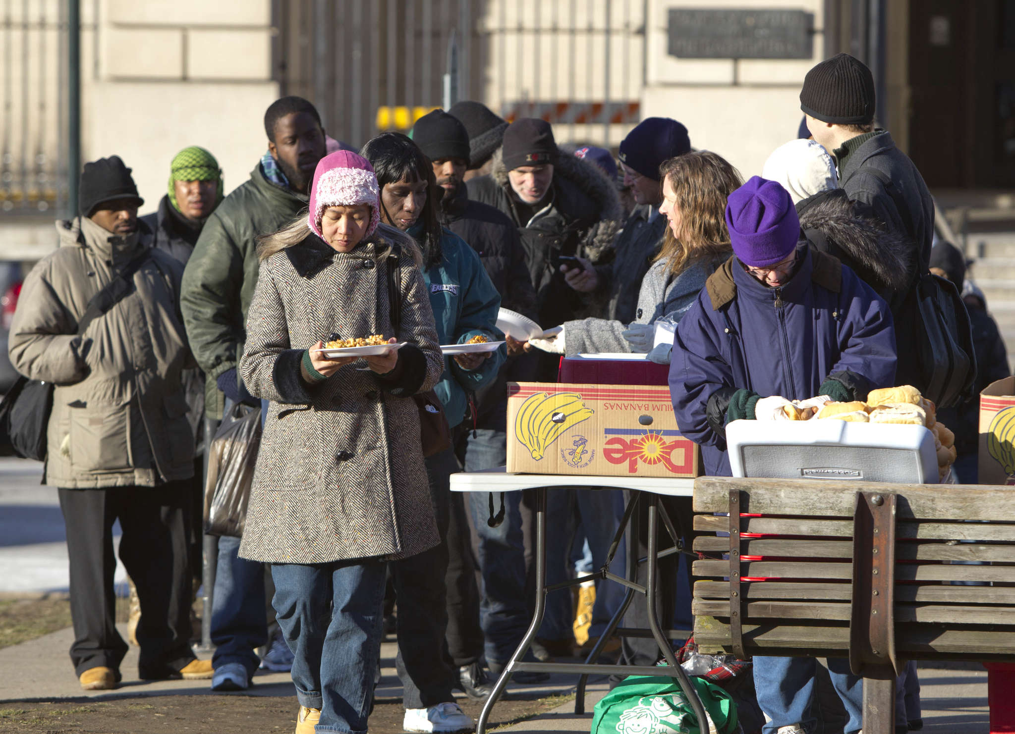 In this 2012 photo, the poor gather in Center City to receive food offered by Philly Restart: Mayor Kenney has lifted the ban on feeding the homeless on the Parkway. DAVID M WARREN / Staff Photographer