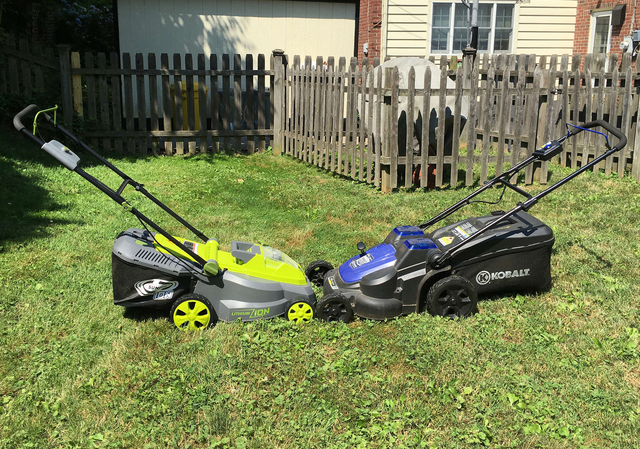 Battery-powered lawn mowers from SunJoe (left) and Kobalt run on rechargeable batteries, and are so quiet that you can hear yourself think.