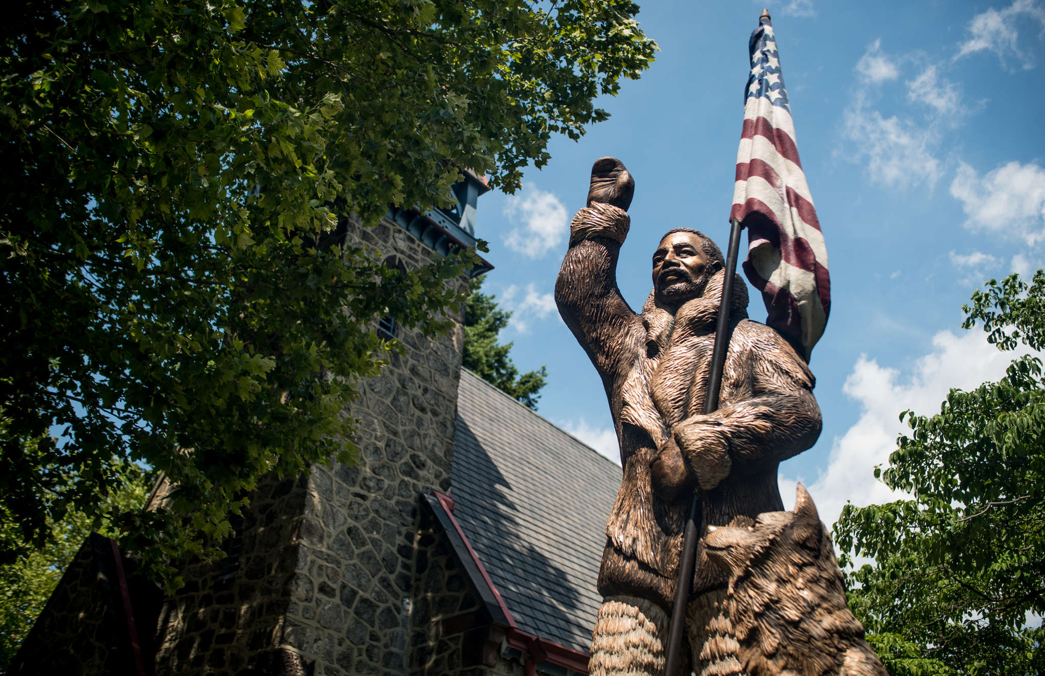 A statue of North Pole explorer Matthew Henson stands outside of the Camden Shipyard & Maritime Museum. The museum, in a former church called the Church of Our Savior, will open in September.