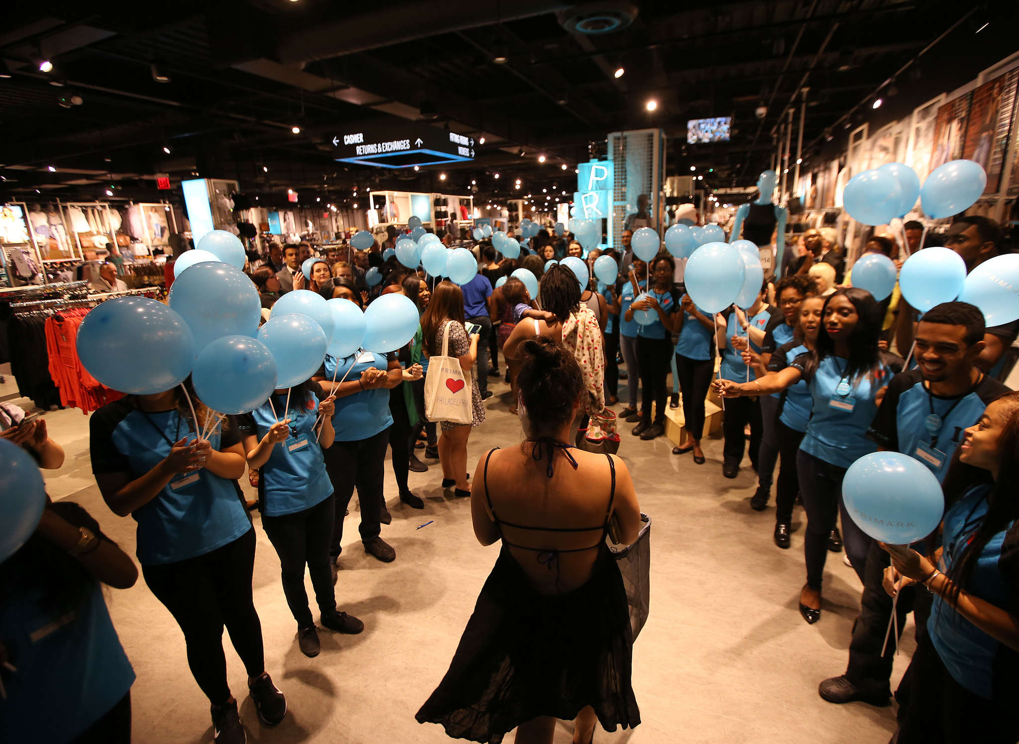 Primark employees greet shoppers during the store´s grand opening at Willow Grove Park Mall.