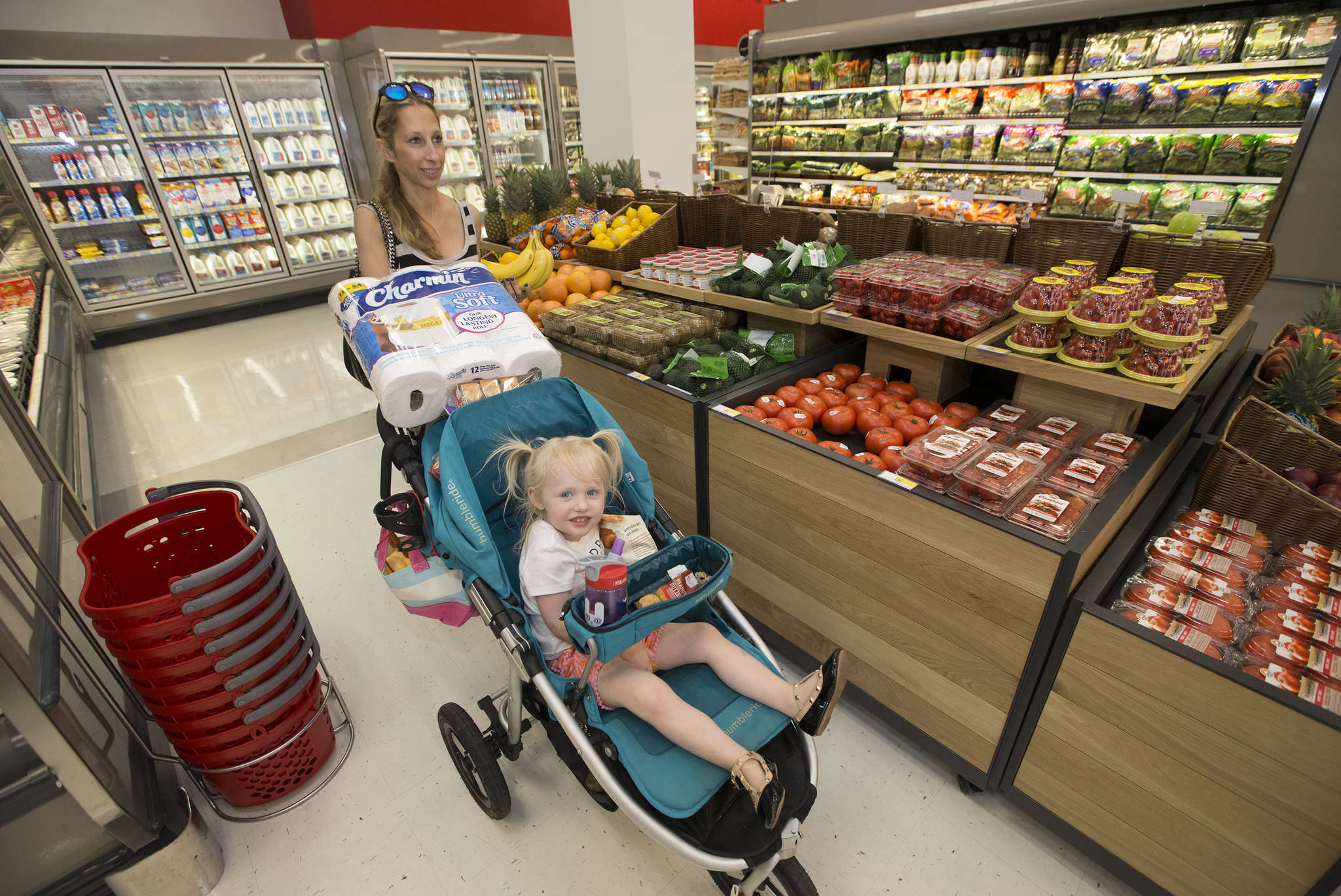 """Darci Yusk and her daughter Blake, 3, make their way through the market section of the Target to pick up some groceries. The """"flexible-format"""" version of the retailer opened Wednesday in the 1100 block of Chestnut Street."""