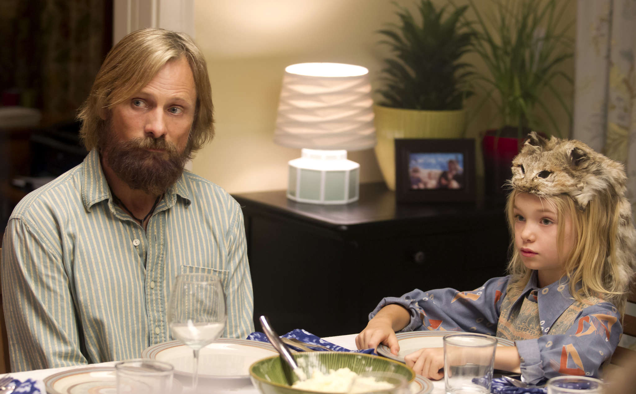 "Viggo Mortensen is radical dad Ben, with Shree Crooks is one of his brood of six, in ""Captain Fantastic,"" a perceptive, piercing, often funny look at what exactly family values are."