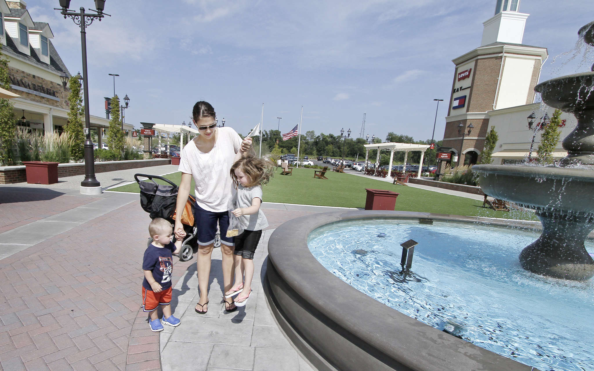 Jamie Annise holds onto children Luke (left) and Rylee at Gloucester Premium Outlets in Blackwood.