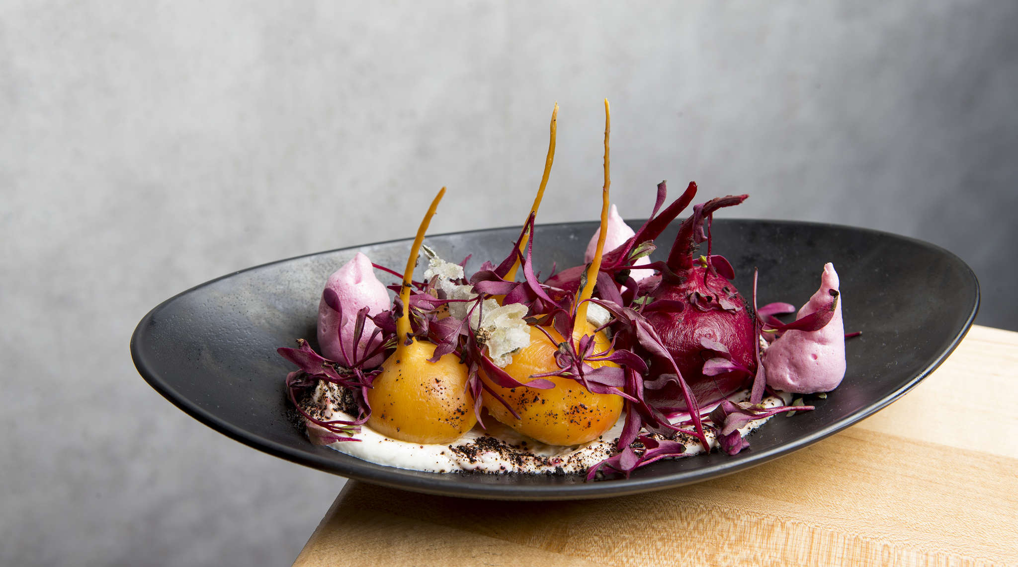 Whole baby beets sit on a smear of goat cheese with meringue crisps at Bistro 7.