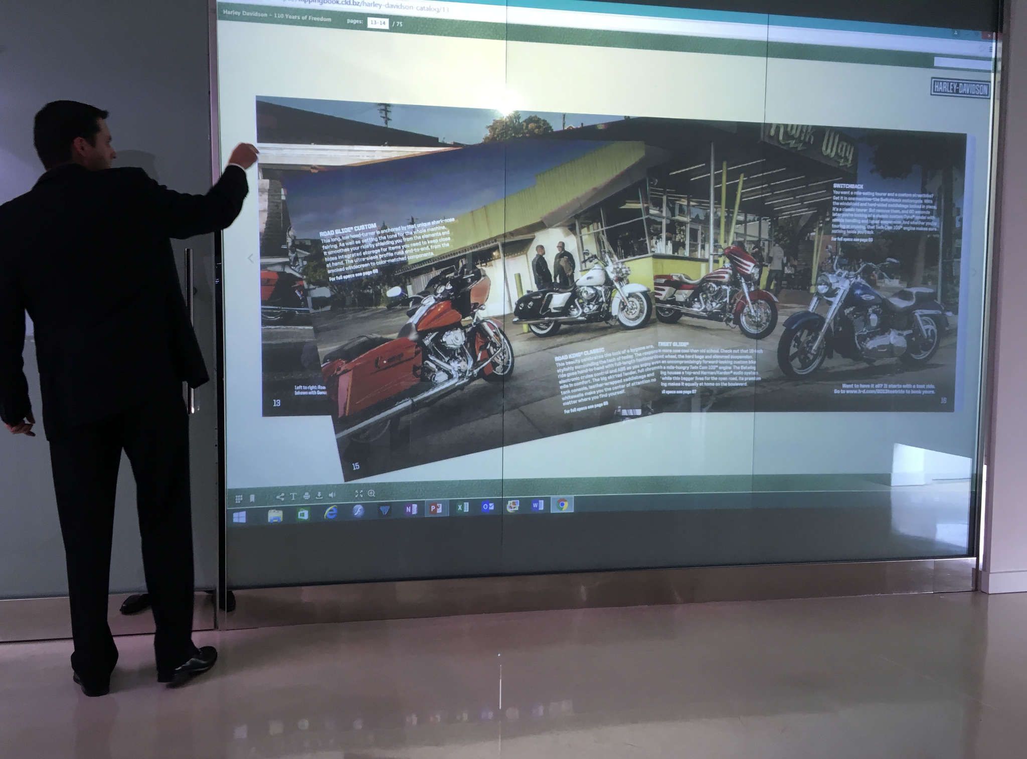 Project developer Michael Holbert demonstrates a supersized smart screen fabricated locally and targeted to meeting room needs.
