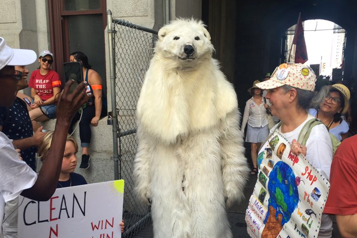 Despite the heat, a protester dressed in a polar bear suit marches as part of the March for a Clean Energy Revolution in Philadelphia.