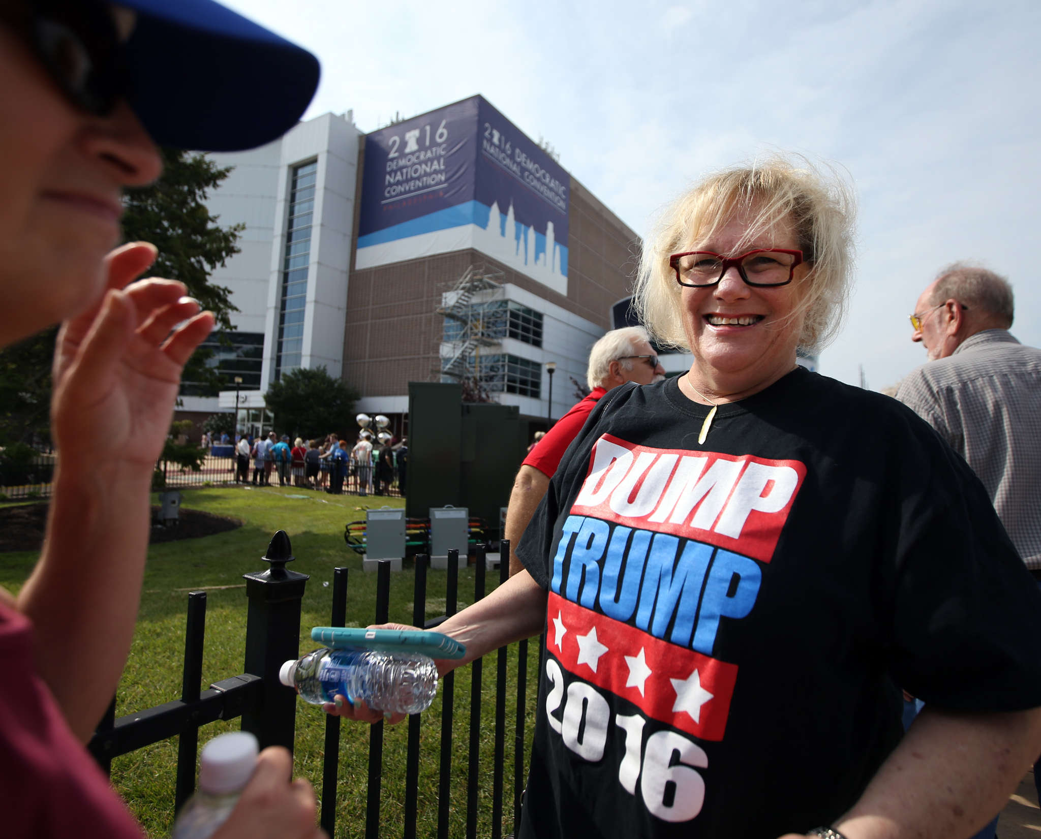 "Lynn Brown , of Philadelphia, with a ""Dump Trump"" as she awaits a tour of the DNC site at Wells Fargo Center. DAVID MAIALETTI / Staff Photographer"