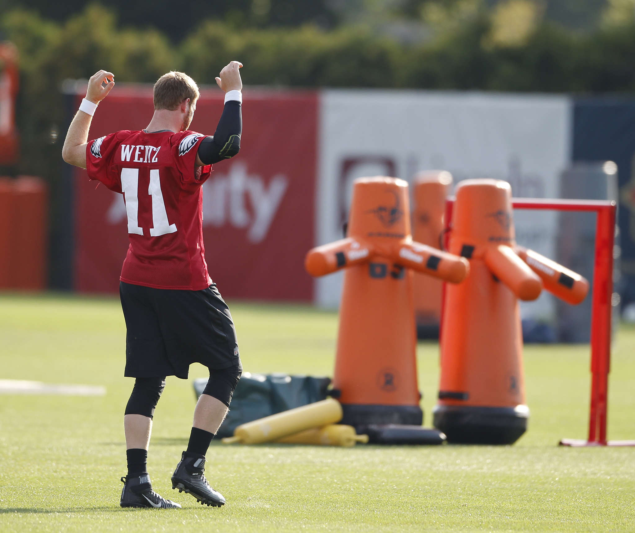 Carson Wentz and practice dummies are armed for a workout yesterday. CHARLES FOX /Staff Photographer