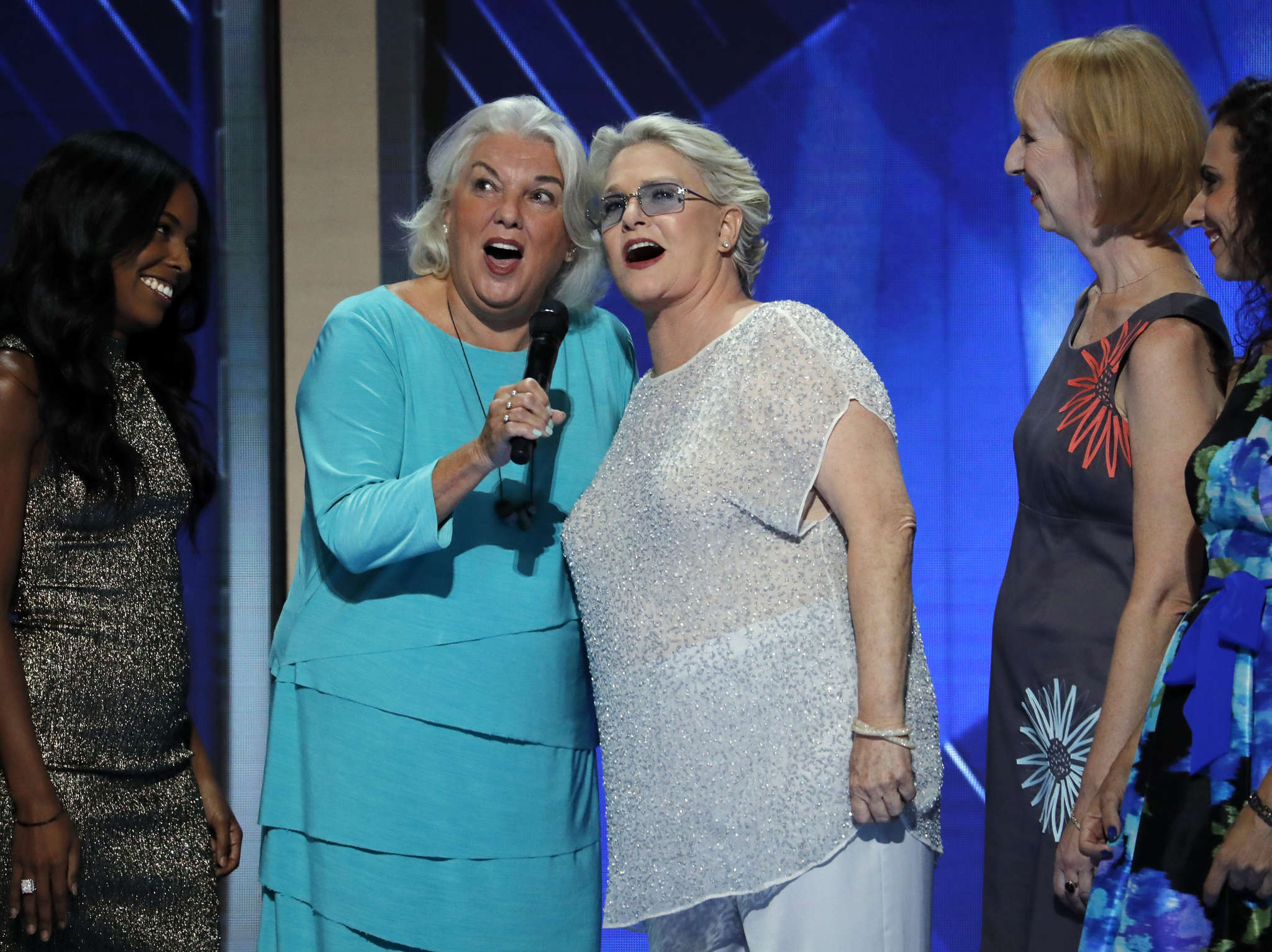 "Actresses Tyne Daly (center left) and Sharon Gless, who starred in the 1980s police drama ""Cagney & Lacey,"" sing ""What the World Needs Now"" during the third day of the DNC."