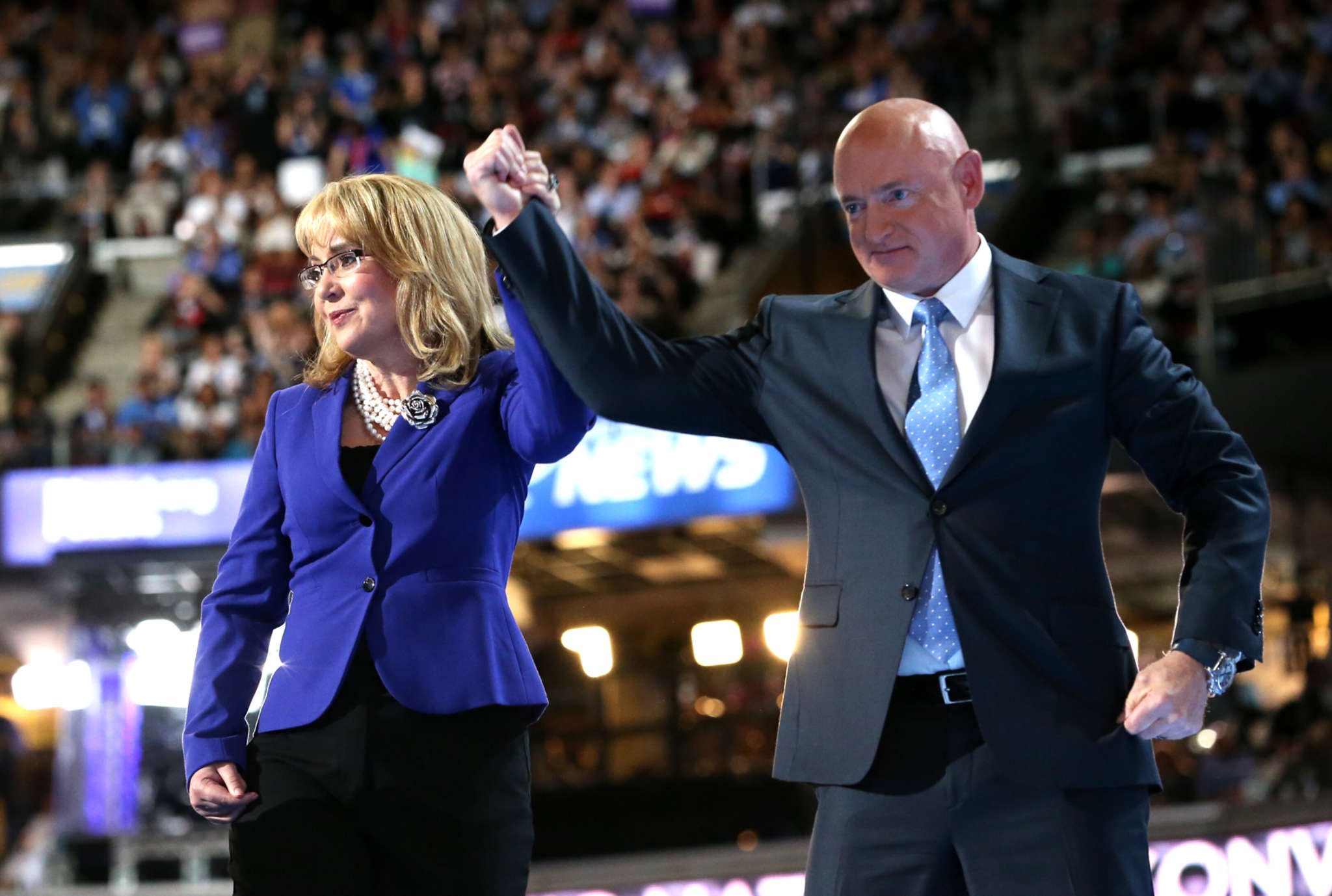 """Former Arizona Rep. Gabrielle Giffords spoke for tighter gun laws and said she hoped to be able to call Hillary Clinton """"Madam President."""""""