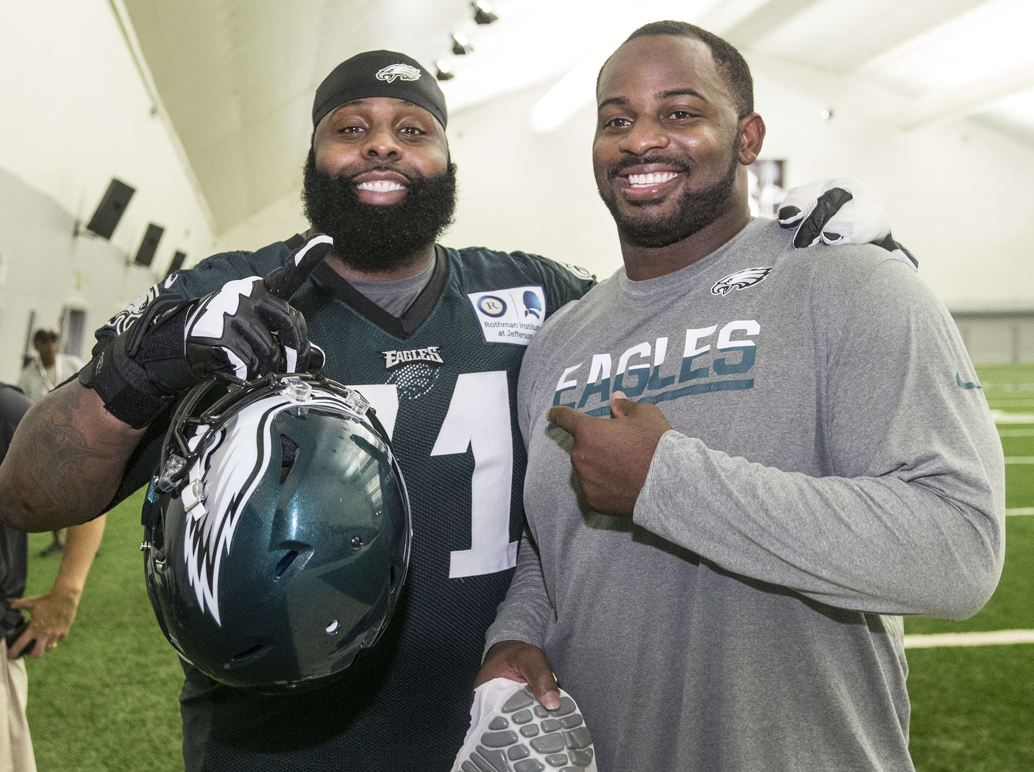 Jason Peters (left) and Fletcher Cox meet up after the Eagles´ first full-squad practice on Thursday. CHARLES FOX / Staff Photographer