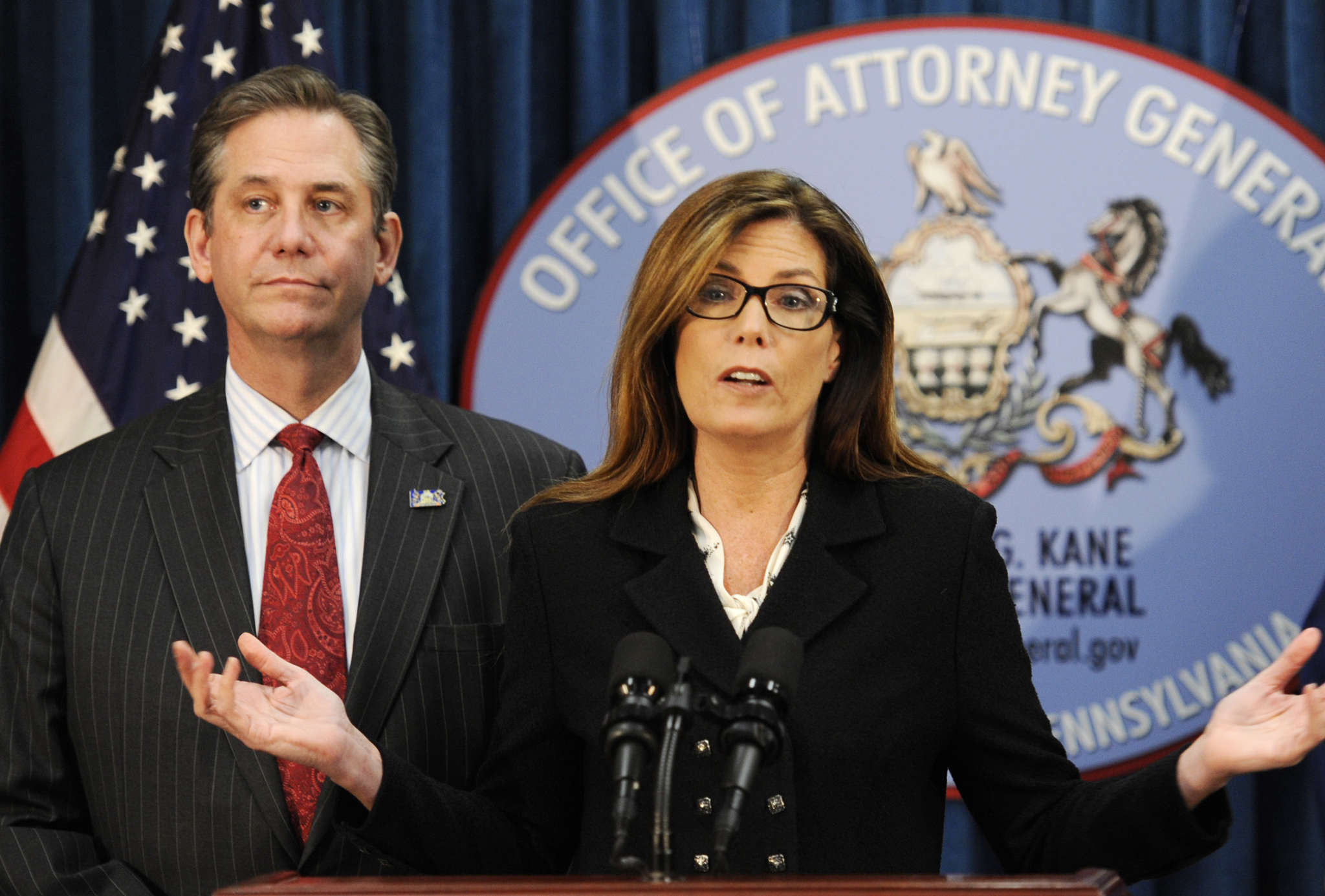 Attorney General Kathleen G. Kane, with First Deputy Attorney General Bruce L. Castor Jr., announces the pact.
