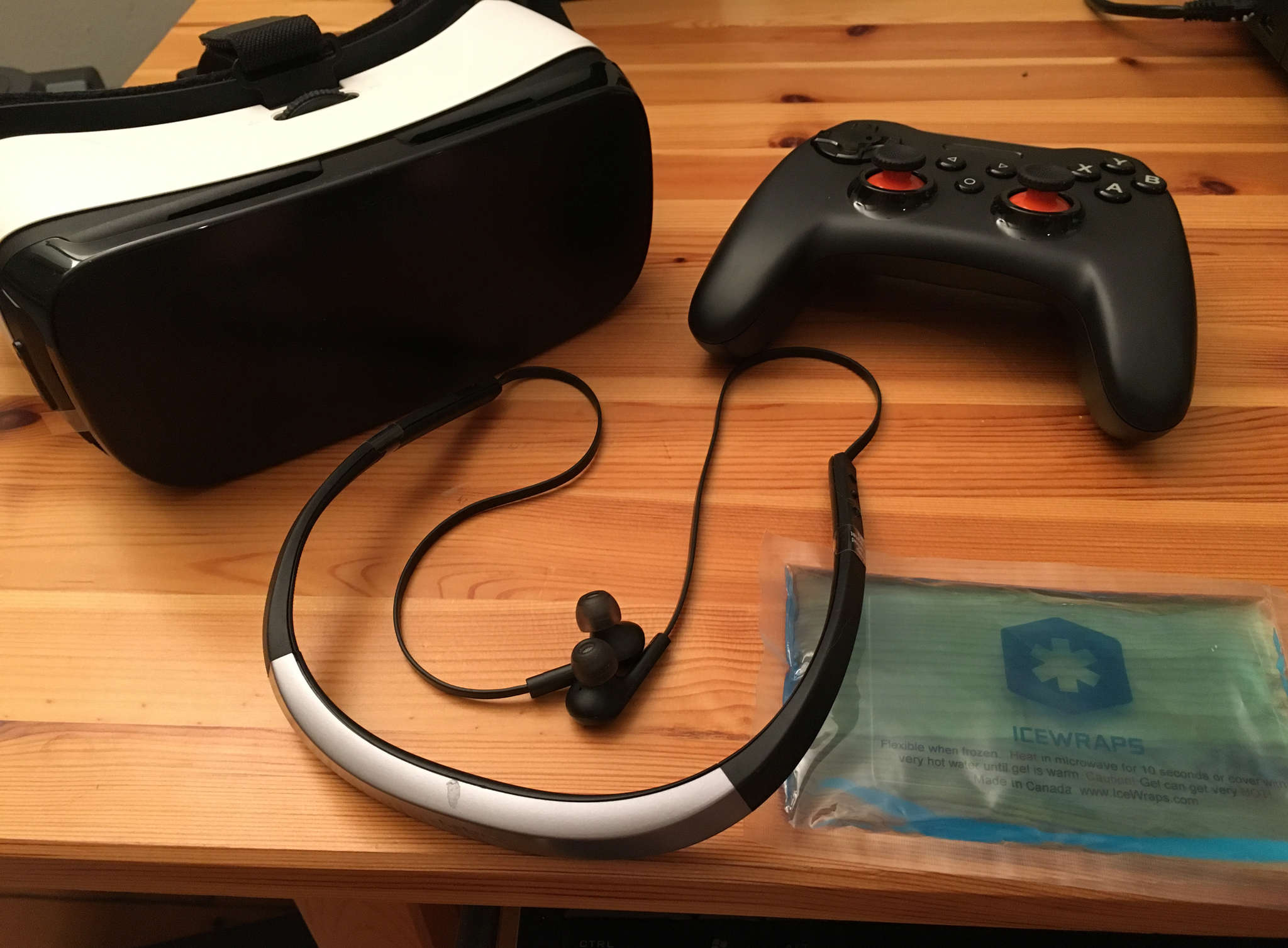 For virtual reality, use the GearVR viewer (left) and listen on a Jabra Halo Smart headset. The SteelSeries Stratus XL controller spins the 360-degree Rio scene.