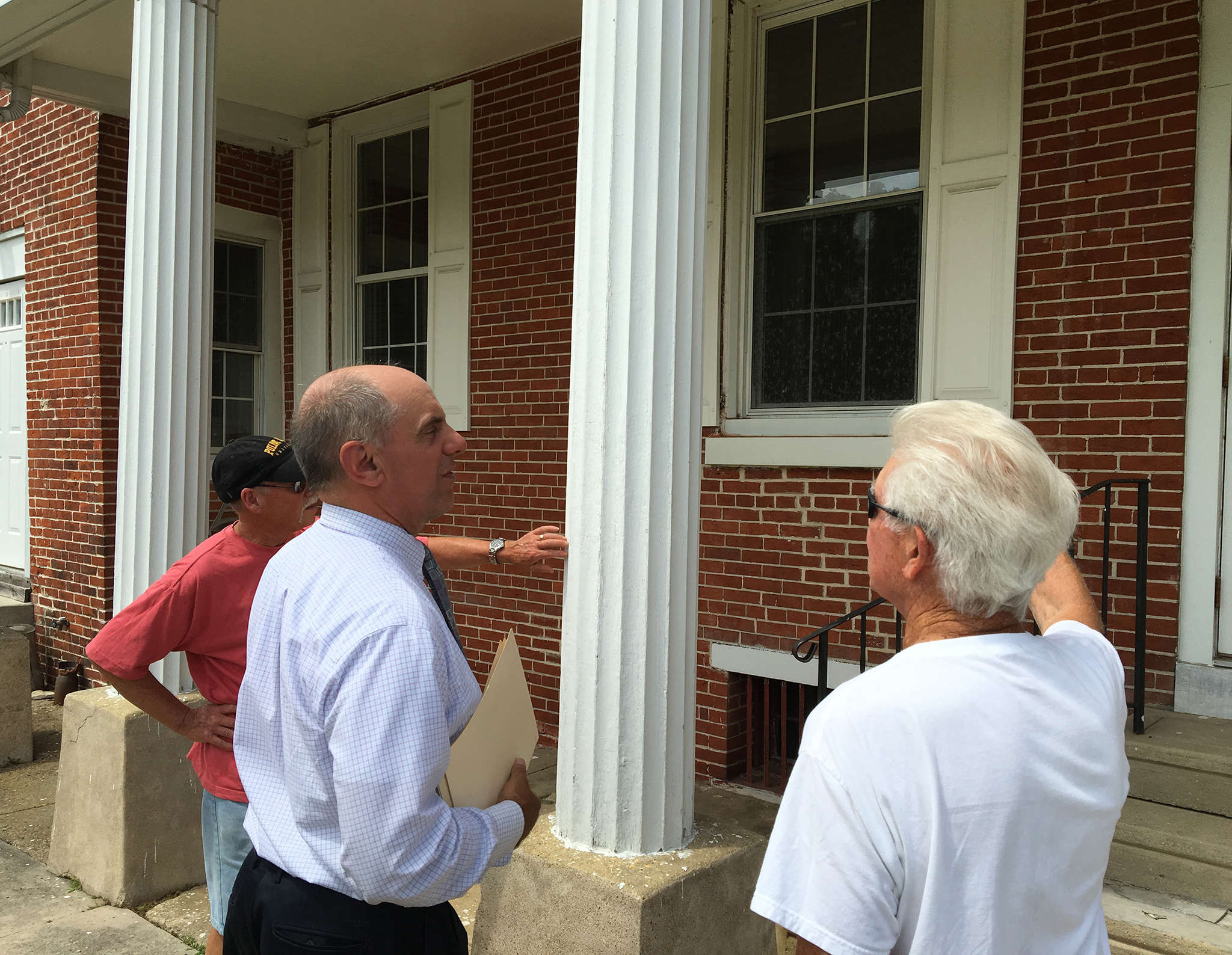 Former Stratford Mayor John Gentless (center), preservationist Ed Claypoole (left), and longtime borough resident Harry Barry are all concerned about what lies in store for the Tomlinson Mansion, built in 1844.