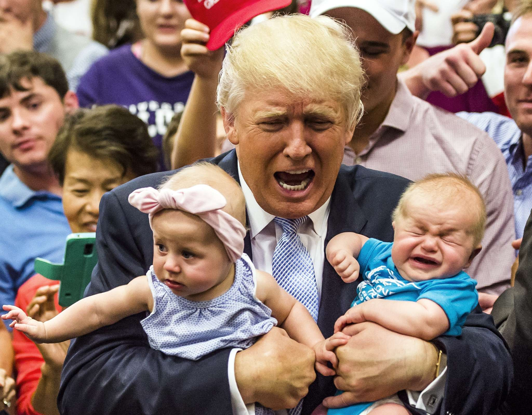 Donald Trump holds baby cousins Evelyn Kate Keane, 6 months, and Kellen Campbell, 3 months, during a campaign stop Friday in Colorado Springs, Colo.