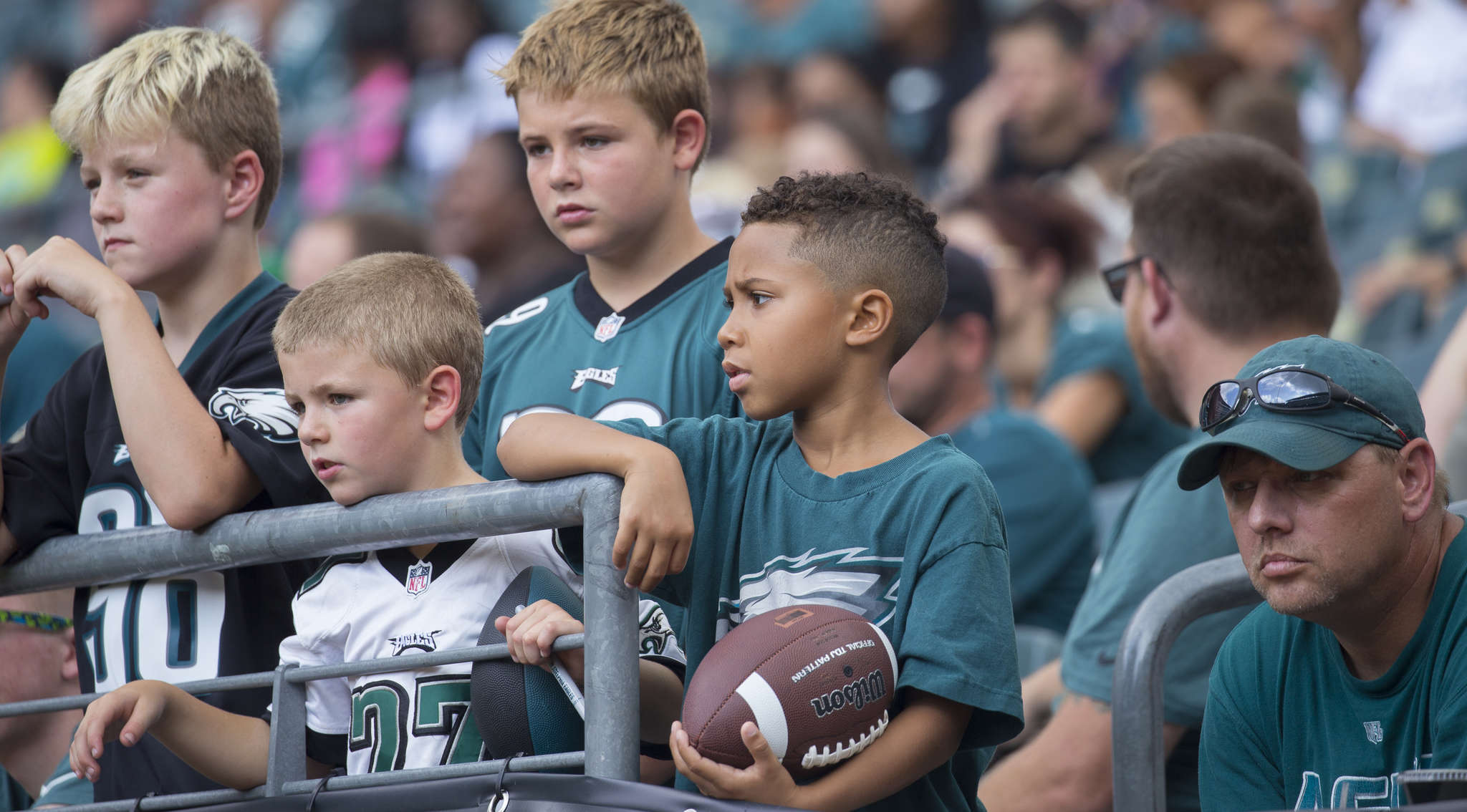Fans make the Linc their wait room, hoping Eagles will head their way so they can get autographs at first open practice Sunday. Jessica Griffin / STAFF PHOTOGRAPHER