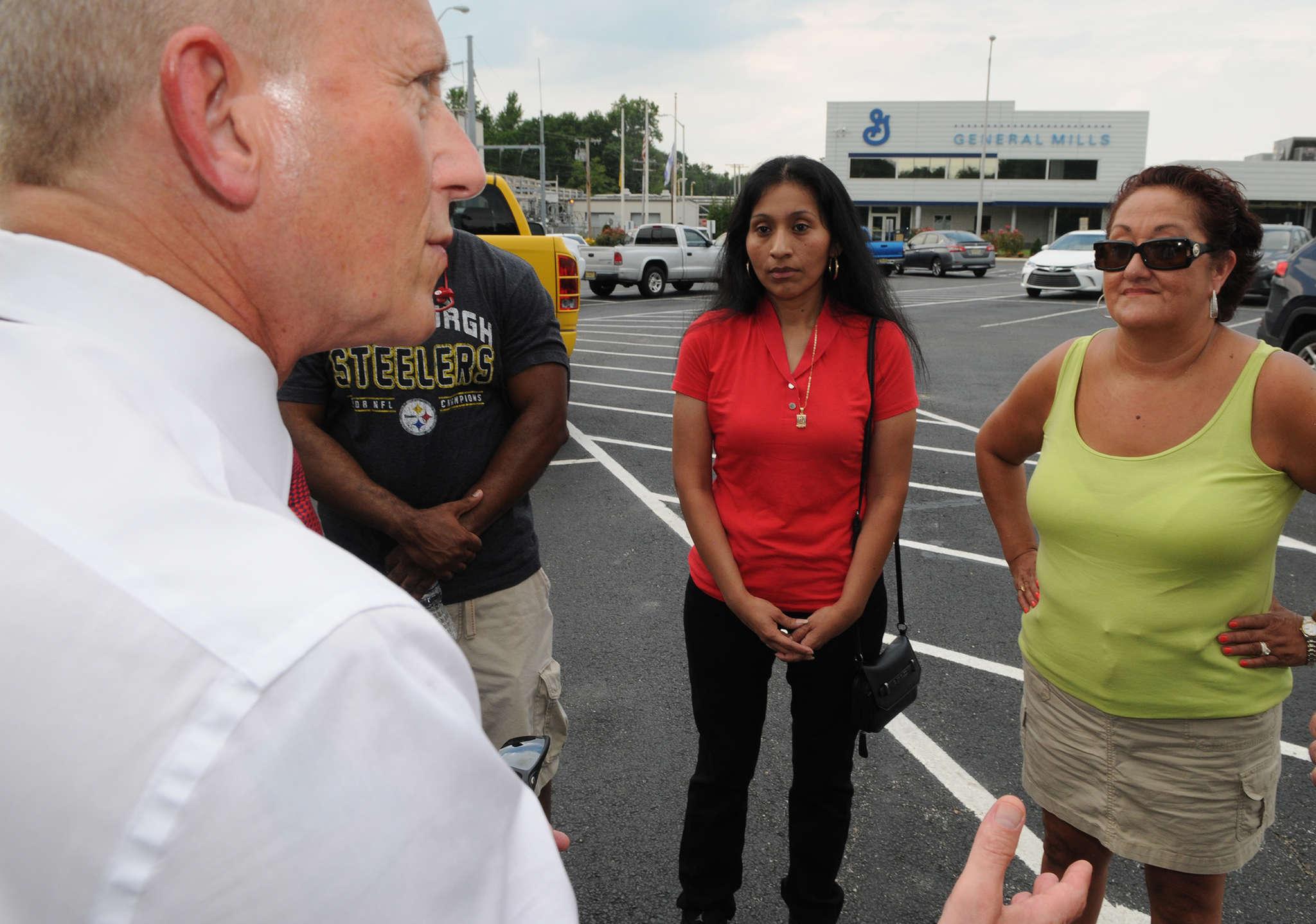 State Sen. Jeff Van Drew talks to Progresso workers (from left) Derrell Jarmon, Rafaela Felipe, and Nelly Lorenzana outside their Vineland plant.