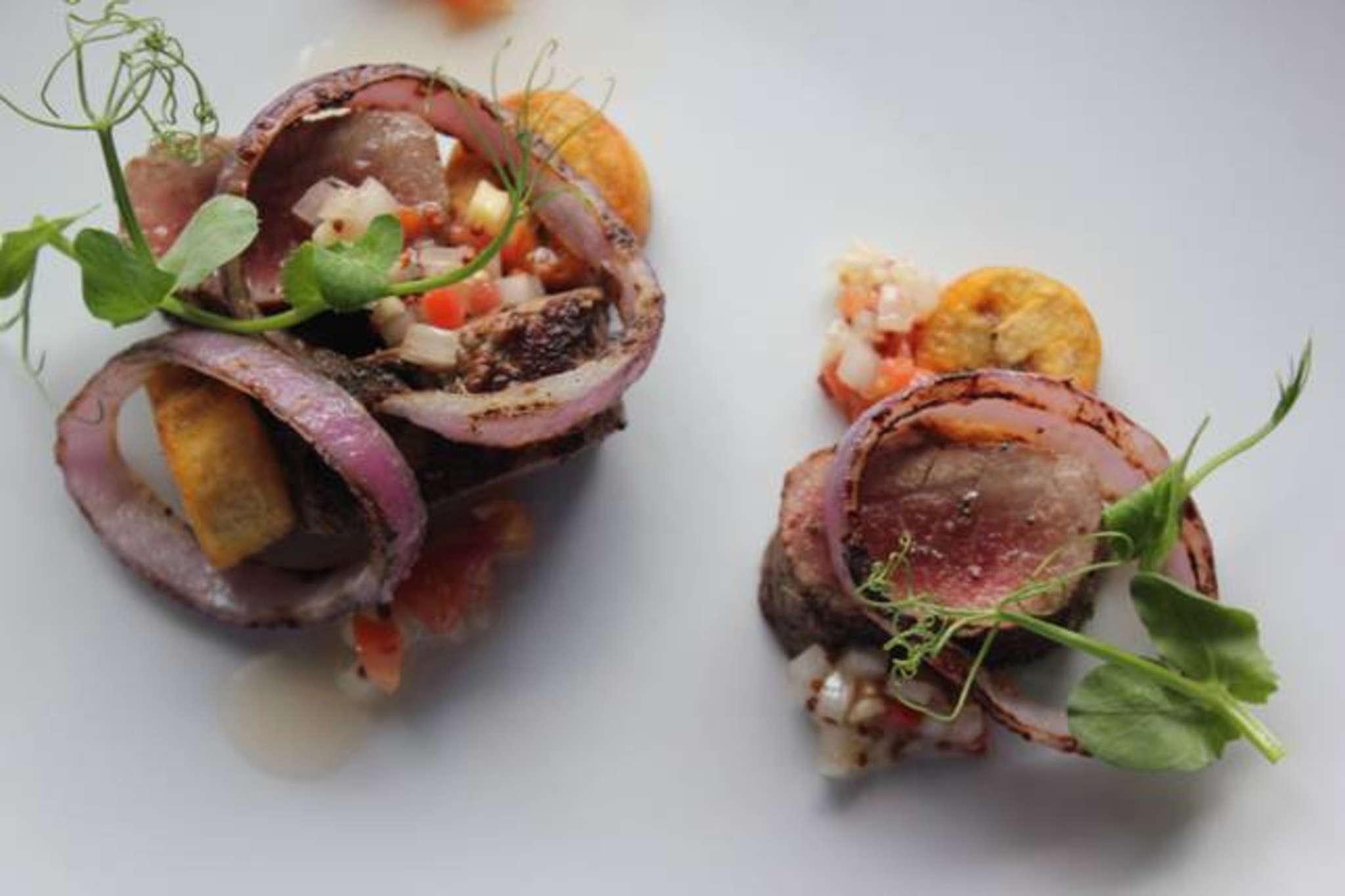 "The grilled lamb loin ""dibi"" with onions and plantains at Sbraga."