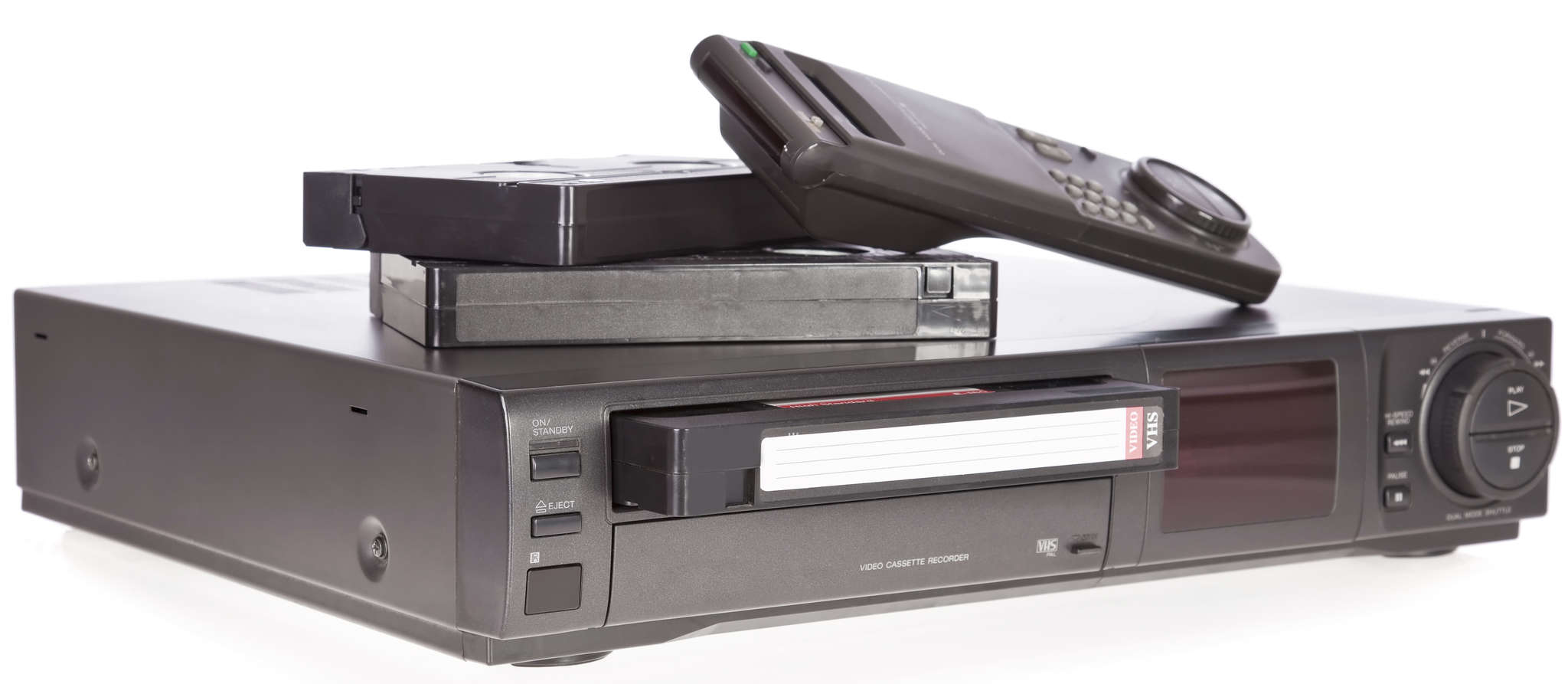 VHS and rival Betamax revolutionized the TV and film industries, users´ viewing habits, and people´s comfort with technology before their decline.