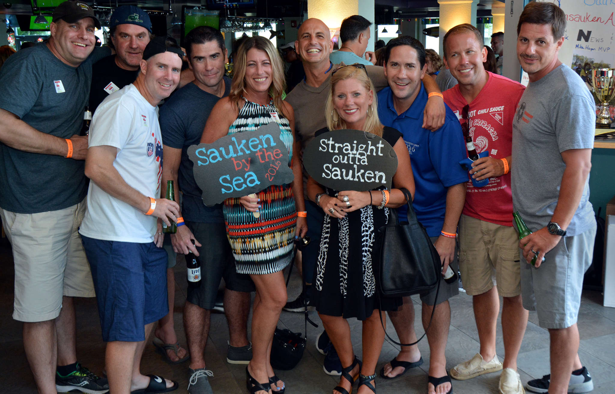 "A group of Pennsauken High School alumni gather for a group photo during ""Sauken by the Sea"" at Flip Flopz Beach Bar & Grill in North Wildwood."